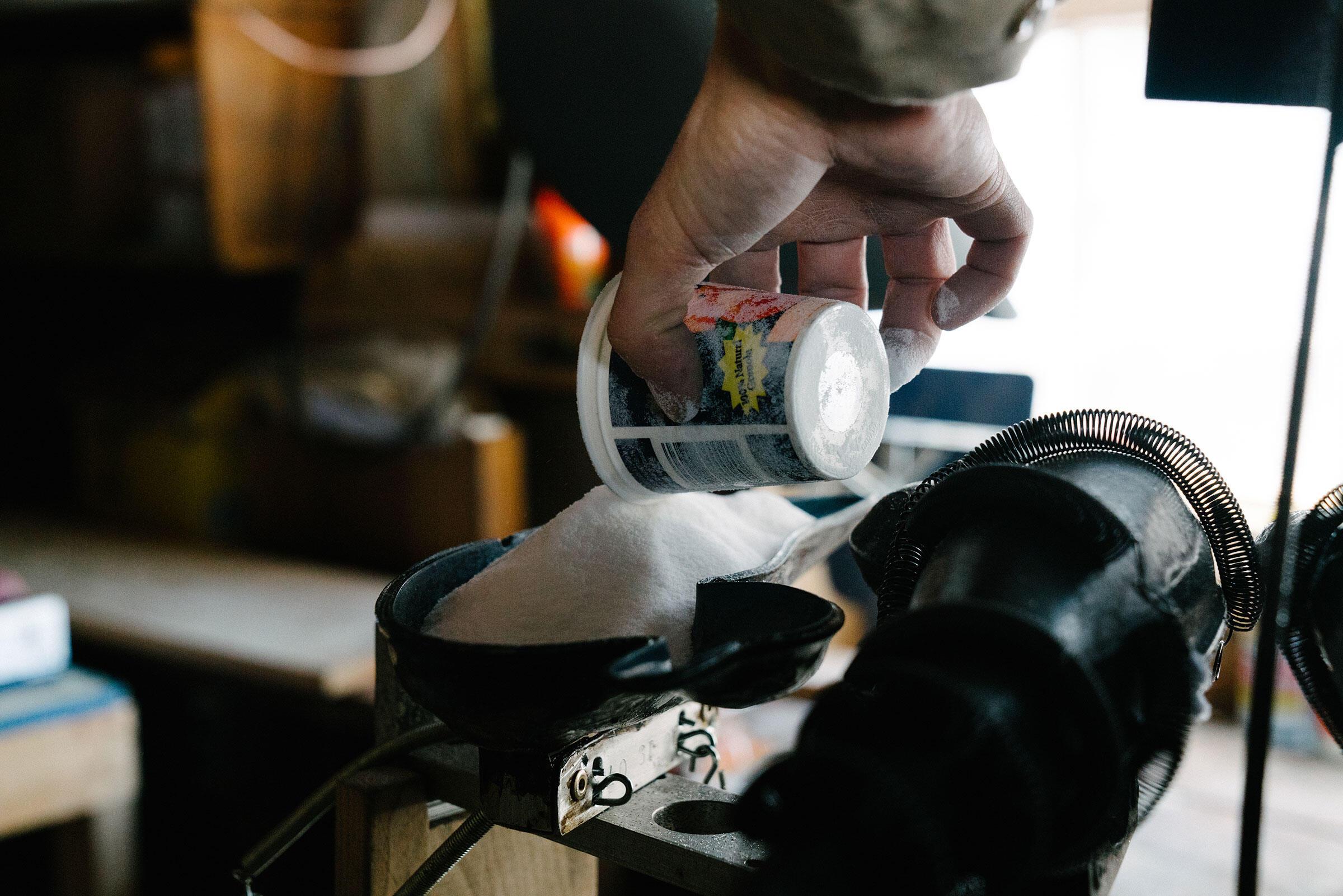 Snyder fills a decoy mold with powered polyethylene. Tristan Spinski