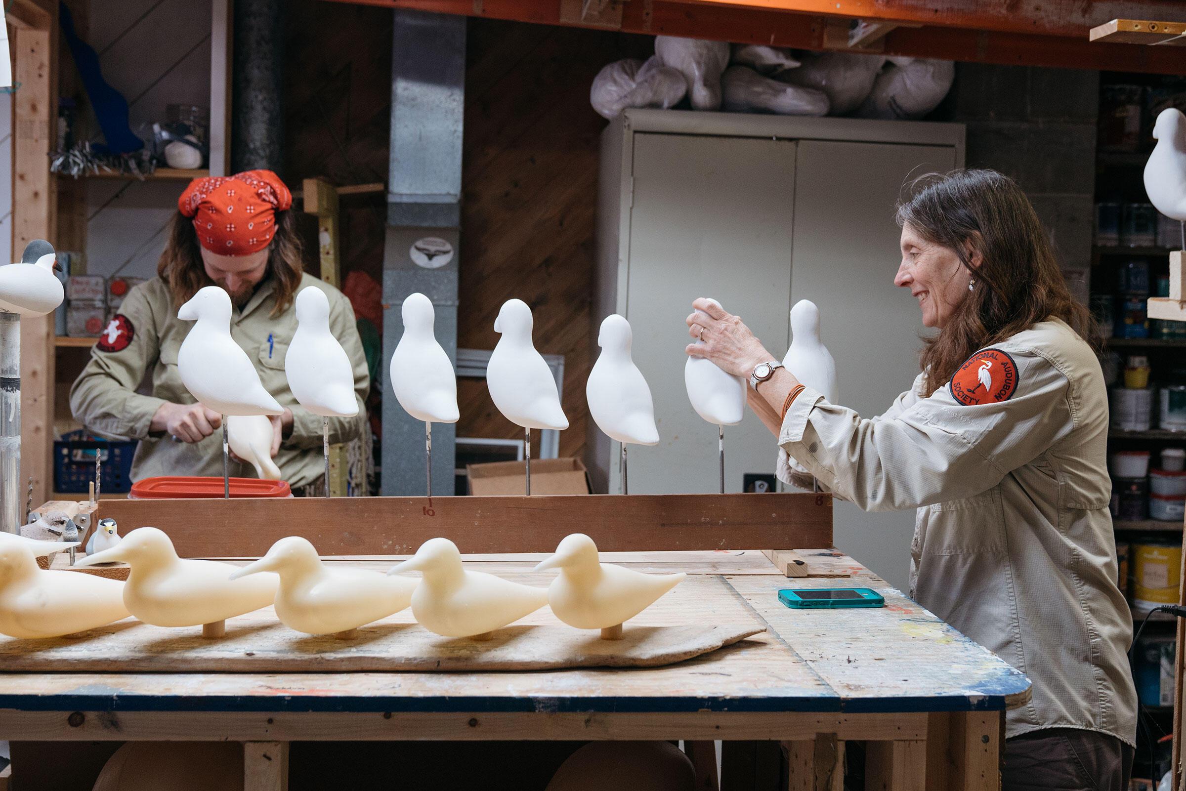 Snyder and Sue Schubel work on a batch of handmade decoys. Tristan Spinski