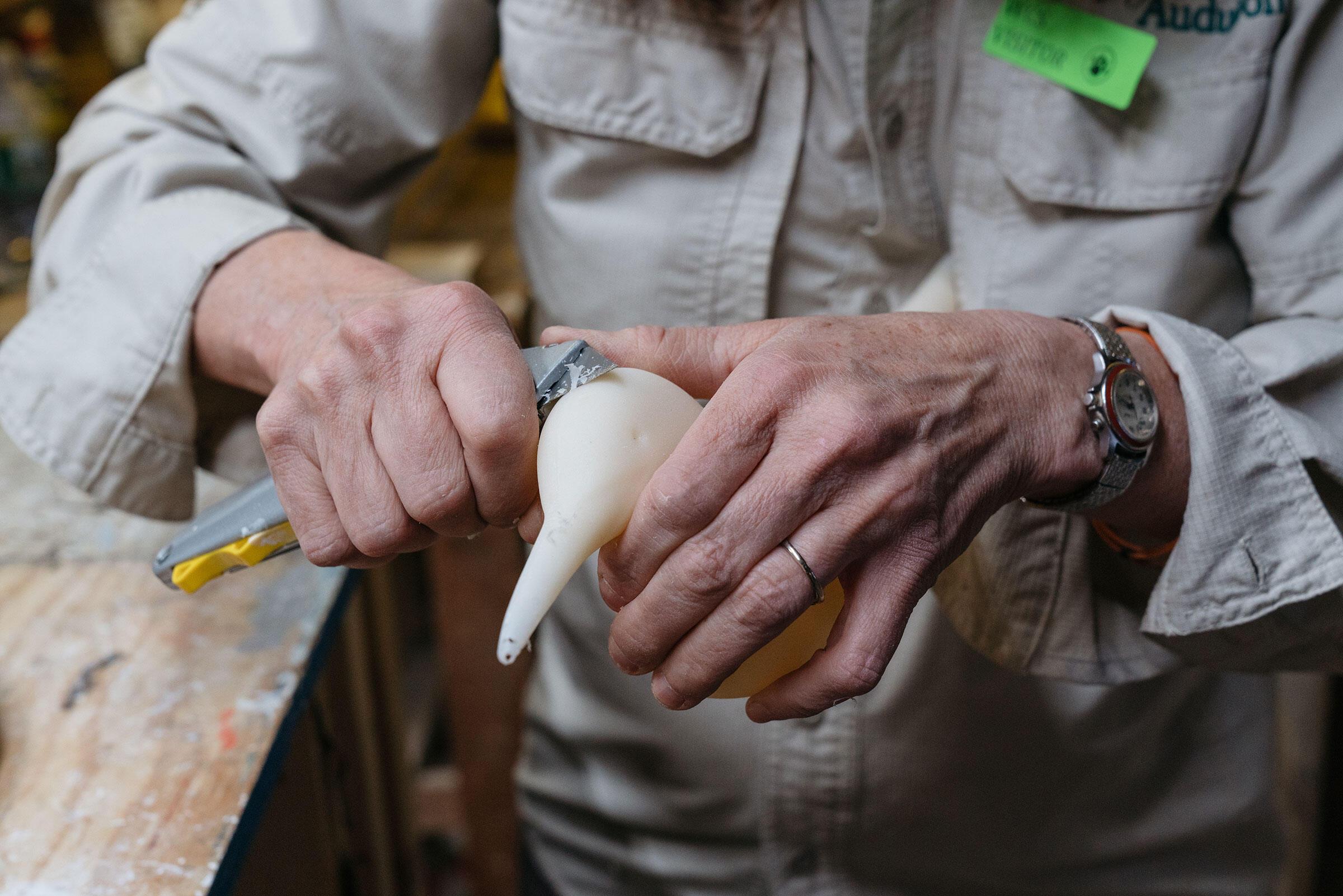 Schubel trims decoy bodies. Tristan Spinski