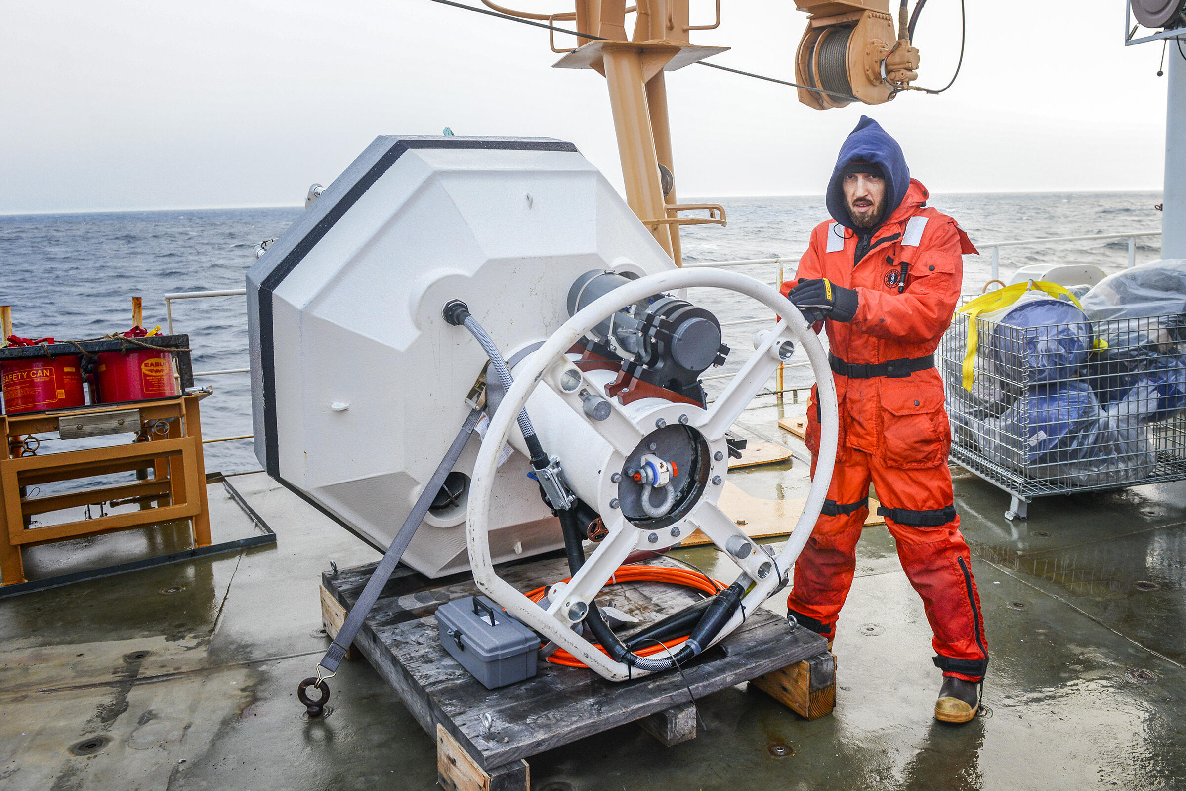 Shaun Bell from UW/JISAO/NOAA with a buoy developed to measure solar radiation in Chukchi Sea. Esther Horvath
