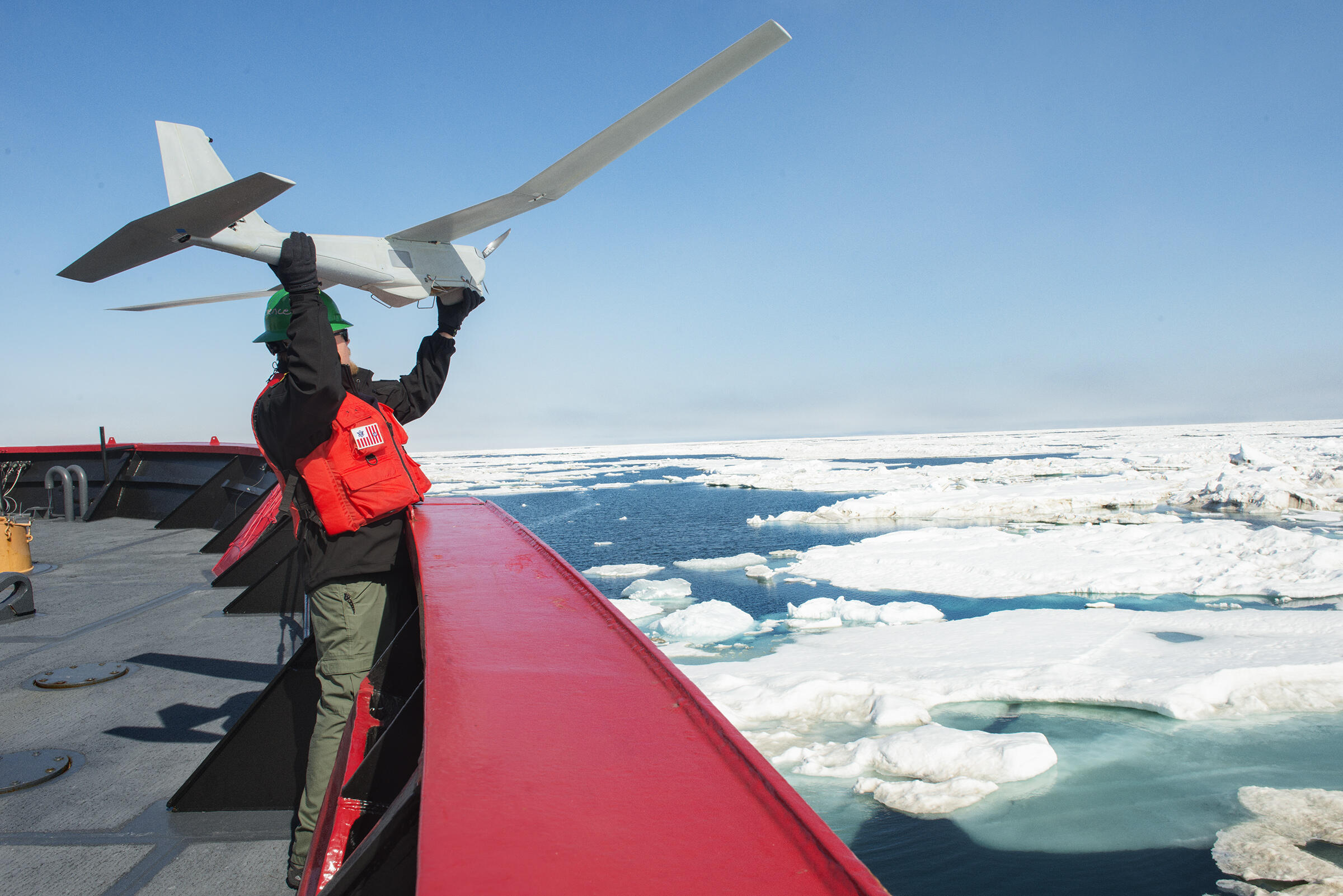 Kevin Vollbrecht lanuches Puma SUAS (small unmanned air system) from US Coast Guard Ship Healy in the Chukchi Sea. Esther Horvath