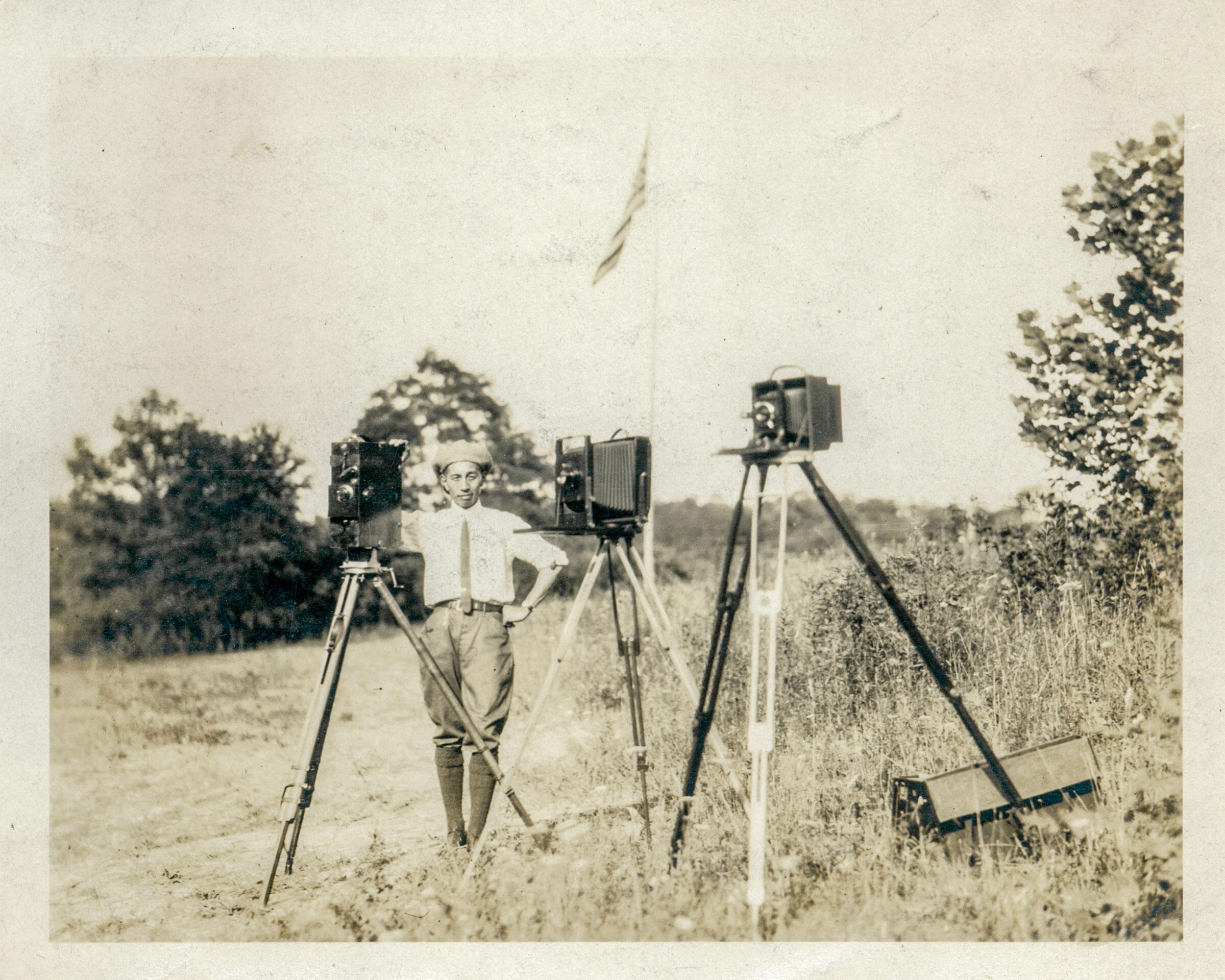 George Masa poses with three view cameras, 1920s. North Carolina Collection, Pack Memorial Public Library