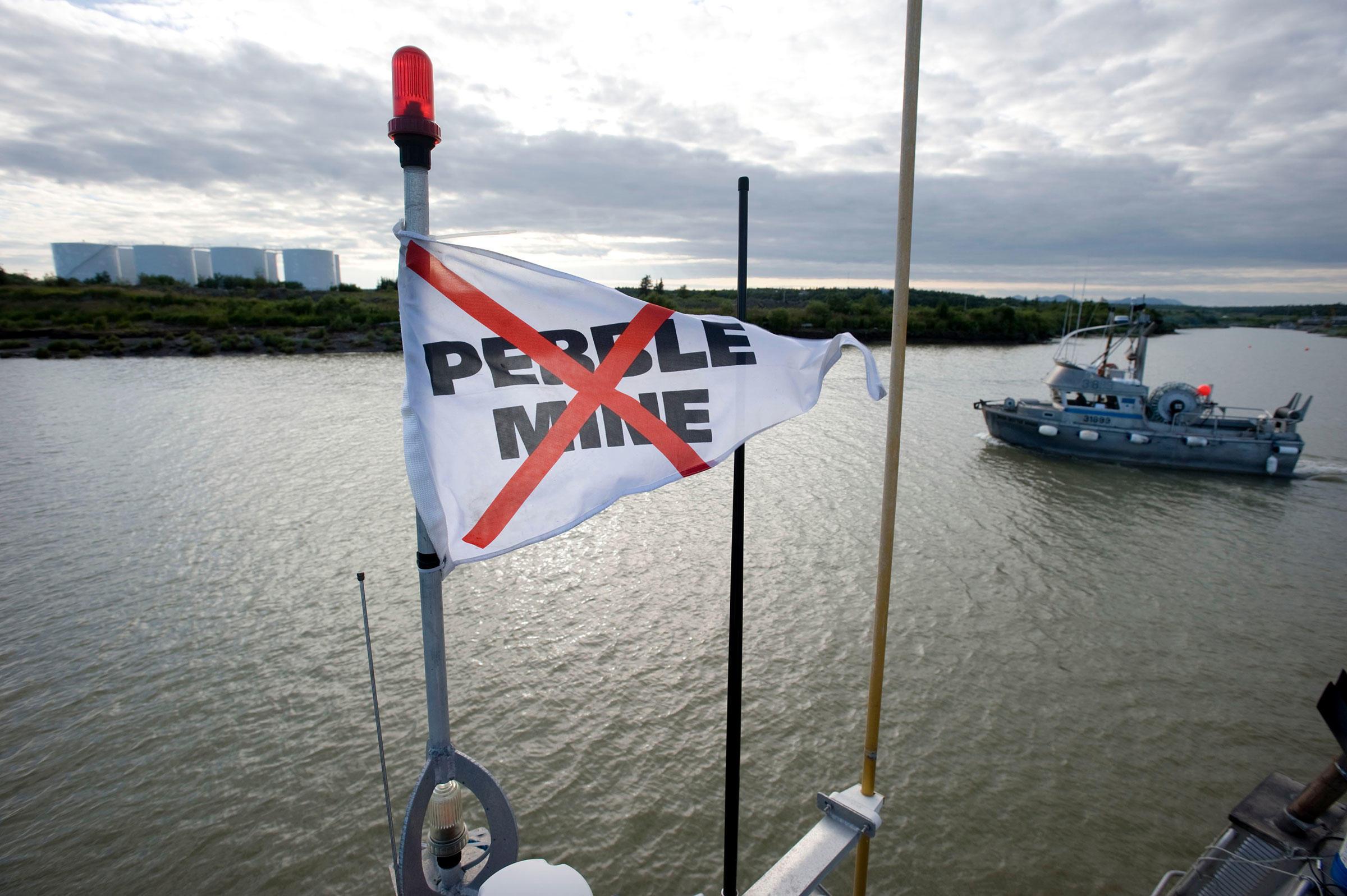 An anti-Pebble Mine flag flies on a salmon fishing boat in Dillingham Port, Alaska. Stuart Isett