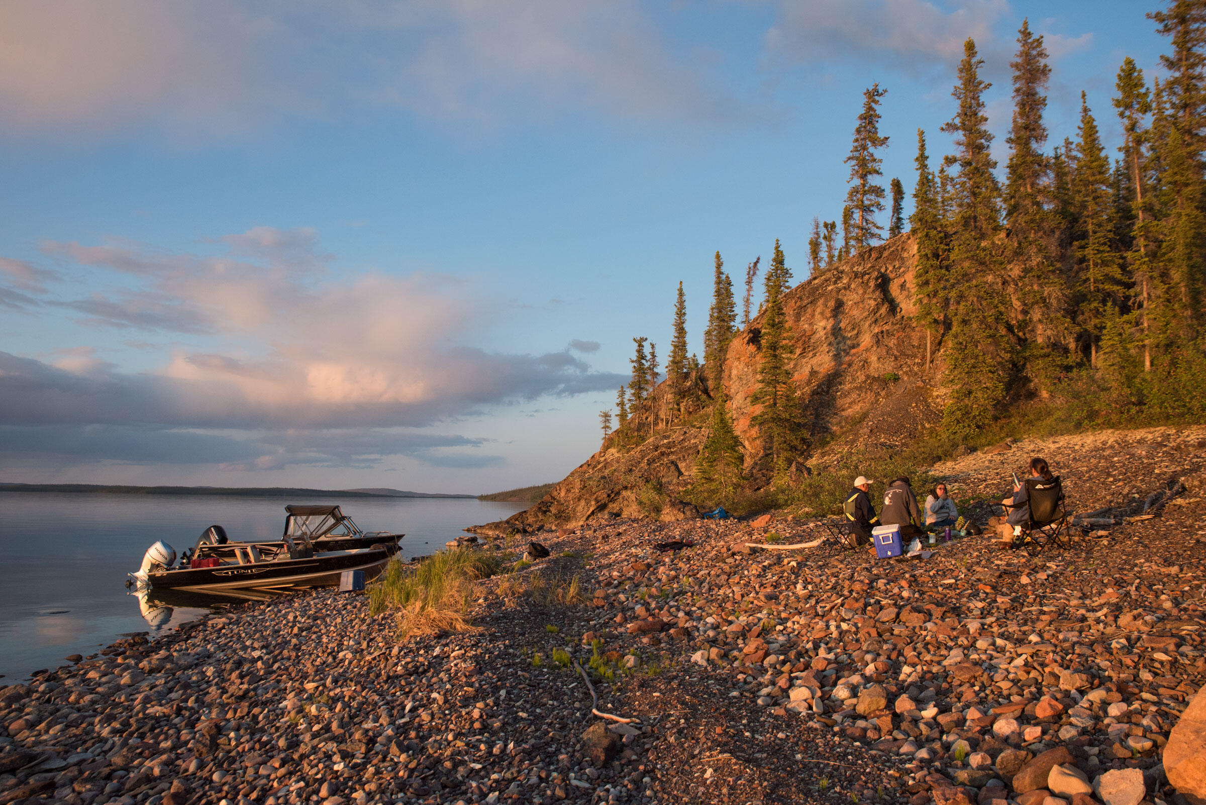 A group shares a dinner of fresh trout on the shore of Great Slave Lake. Pat Kane