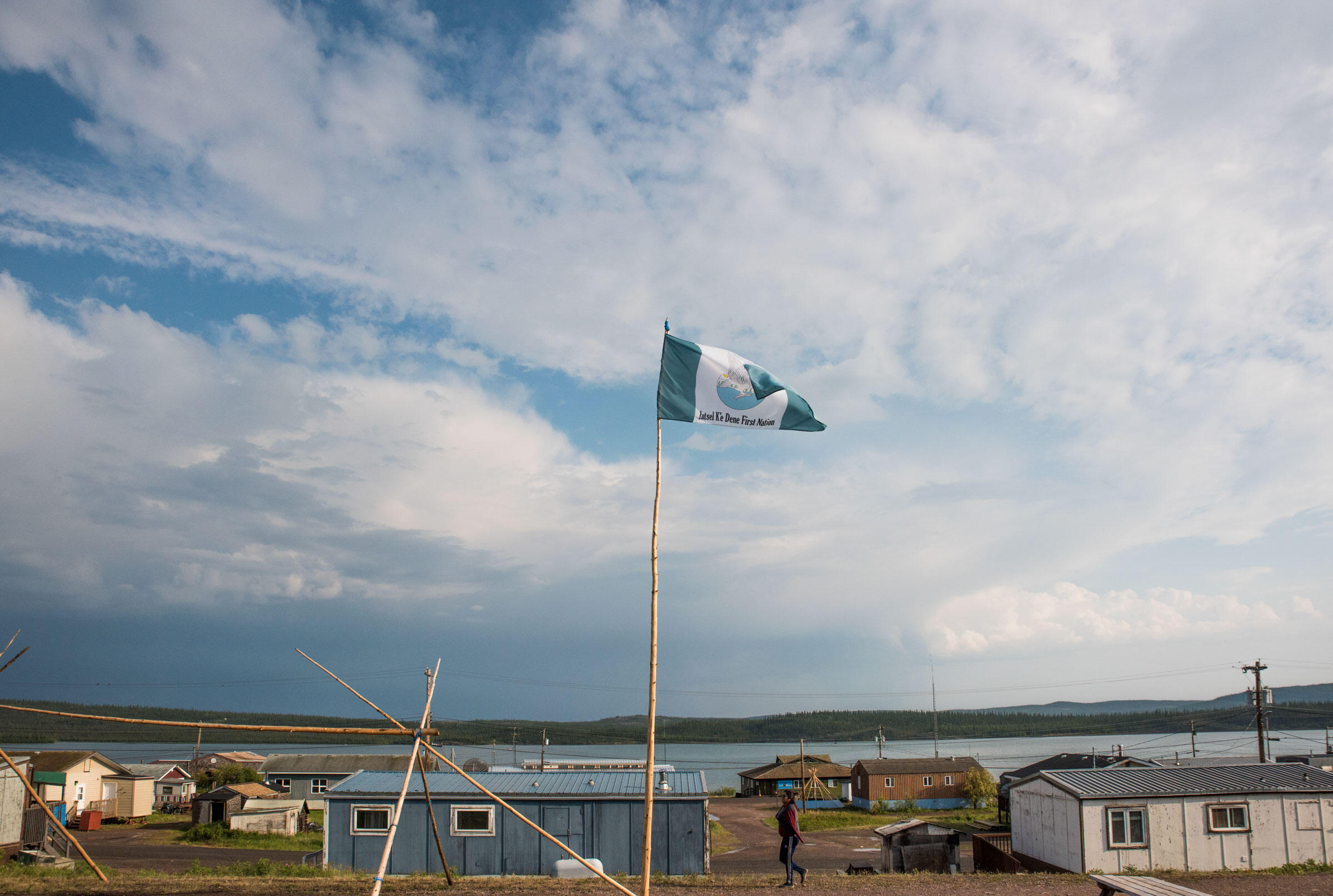 The flag of the Łutsël K'é Dene First Nation shows an eagle catching a fish from a river. Pat Kane