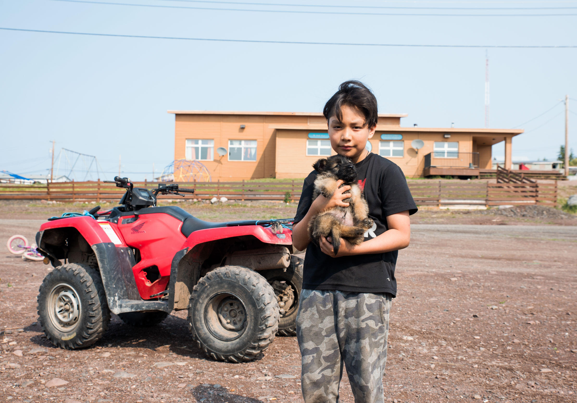 Morris Watchpees holds his puppy Thunder near the community hall in Lutsel K'e. Pat Kane