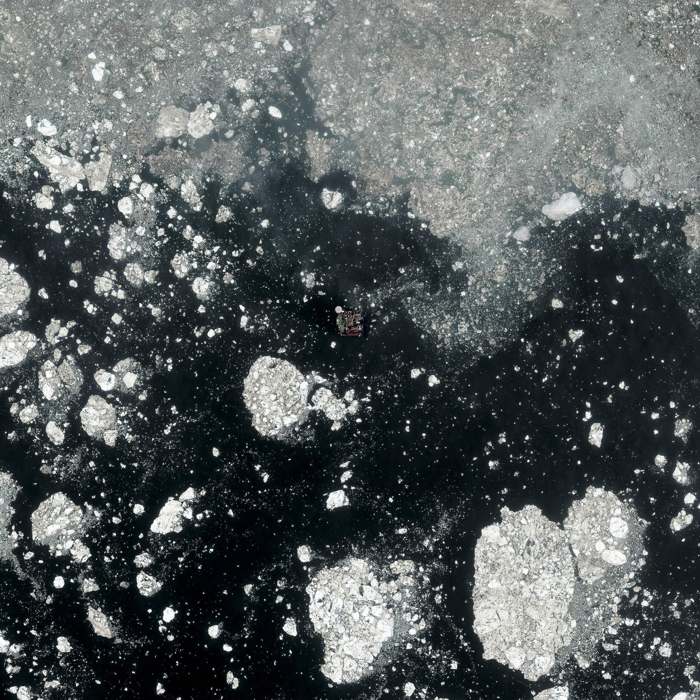 An oil platform at the Prirazlomnoye field in the Pechora Sea, off western Siberia. 6/28/2014. Daily Overview | Satellite images (c) 2015, DigitalGlobe, Inc.