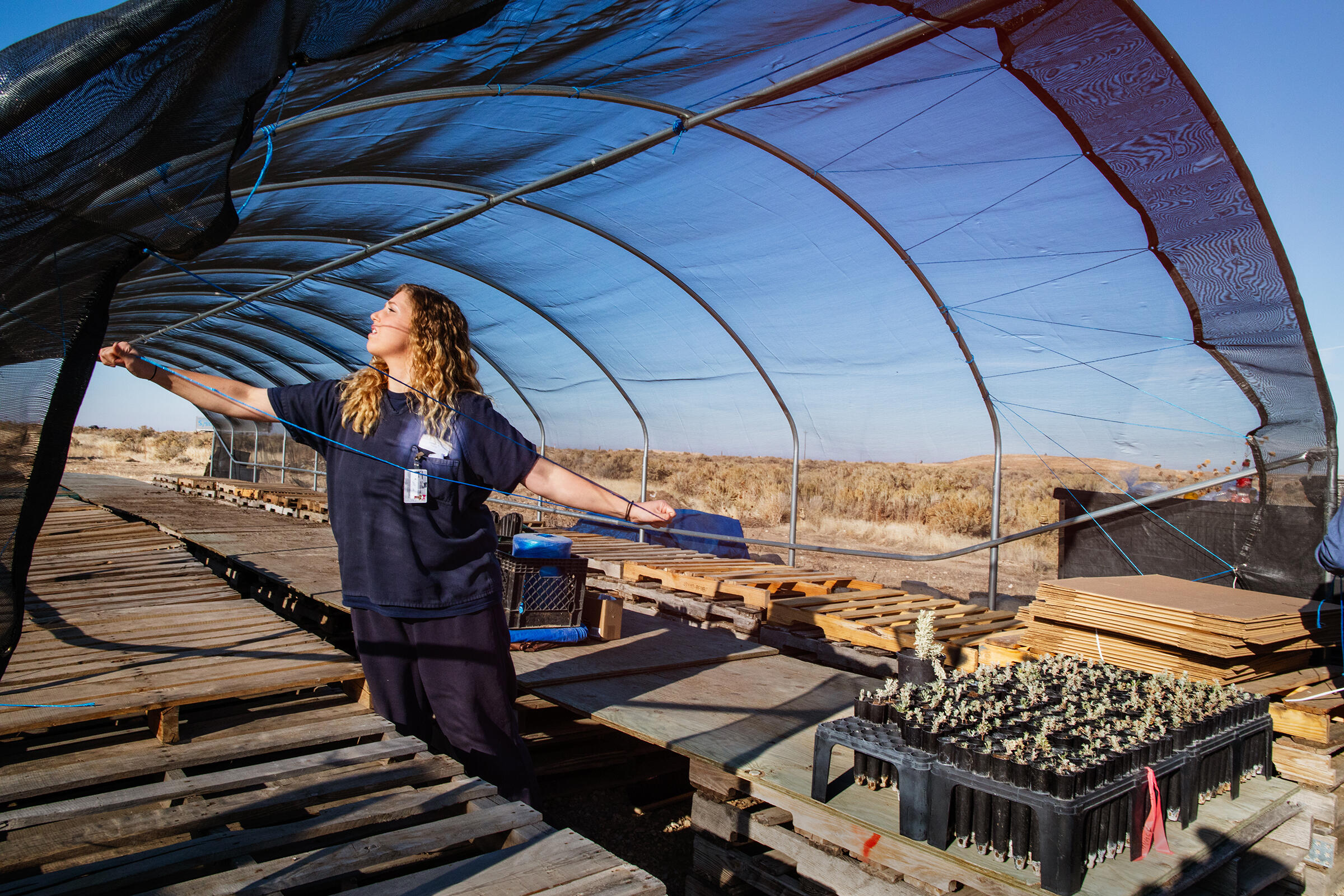 After a successful growing season at the South Boise Women's Correctional Center, Kaitlin Derby helps to take down the the hoop house for winter. Mike Fernandez/Audubon