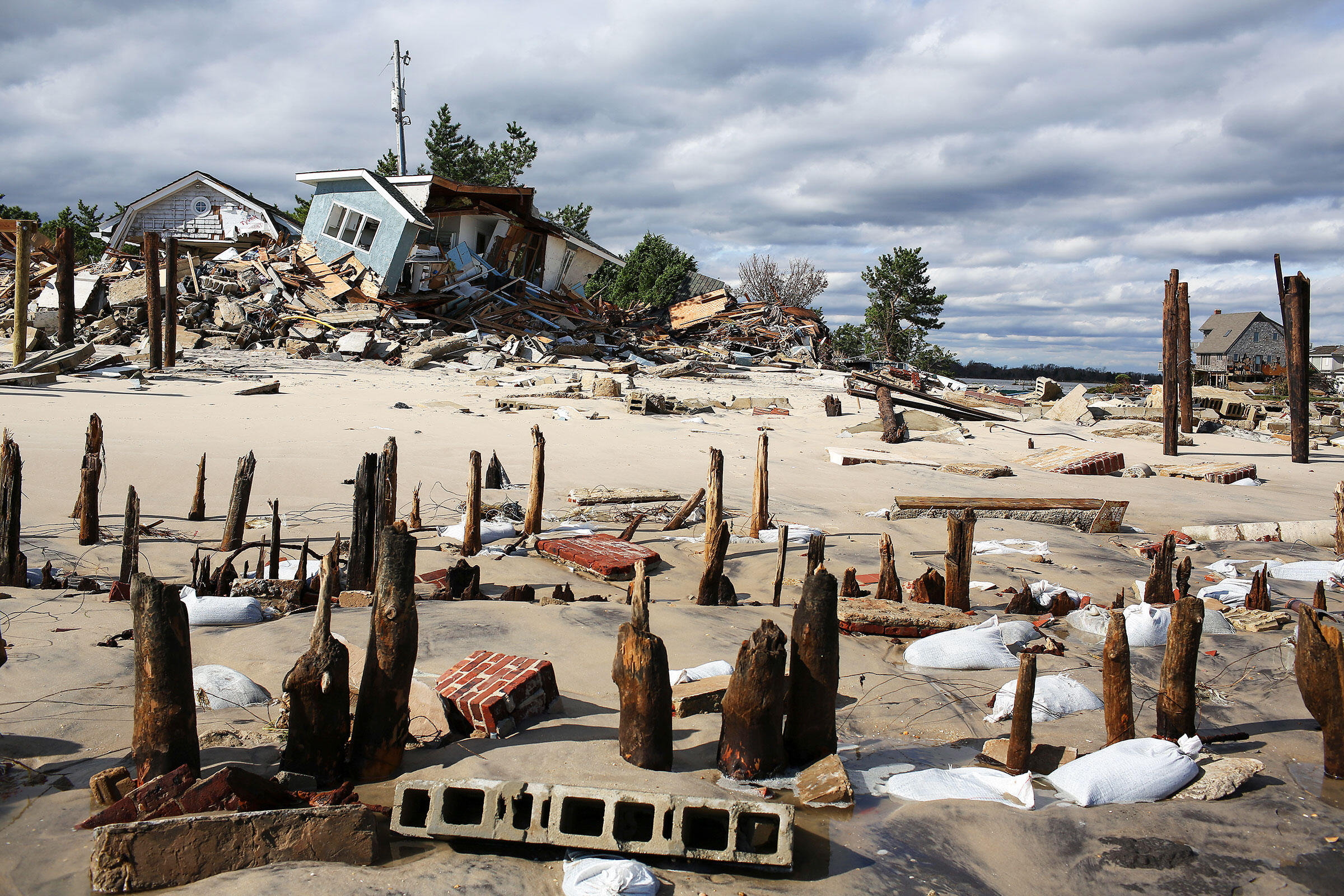 The ruins of the beachfront boardwalk and houses in Mantoloking, NJ, destroyed by Hurricane Sandy. Andrew Quilty/Oculi/Redux