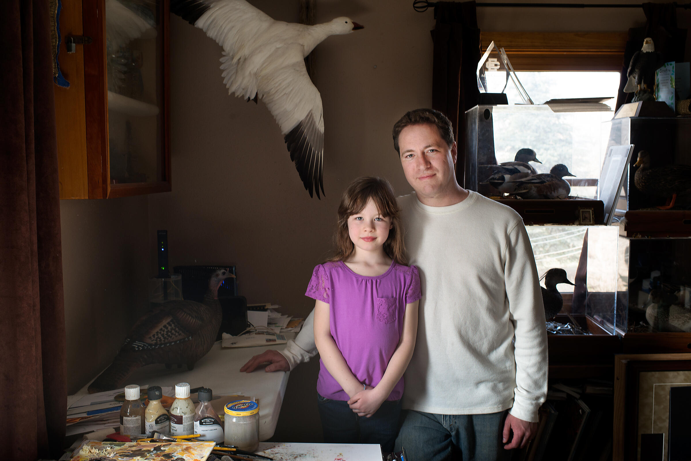 Adam Grimm with his seven-year-old daughter, Madison, who last year became the youngest artist ever to win the Junior Duck Stamp Contest. Jon Lowenstein
