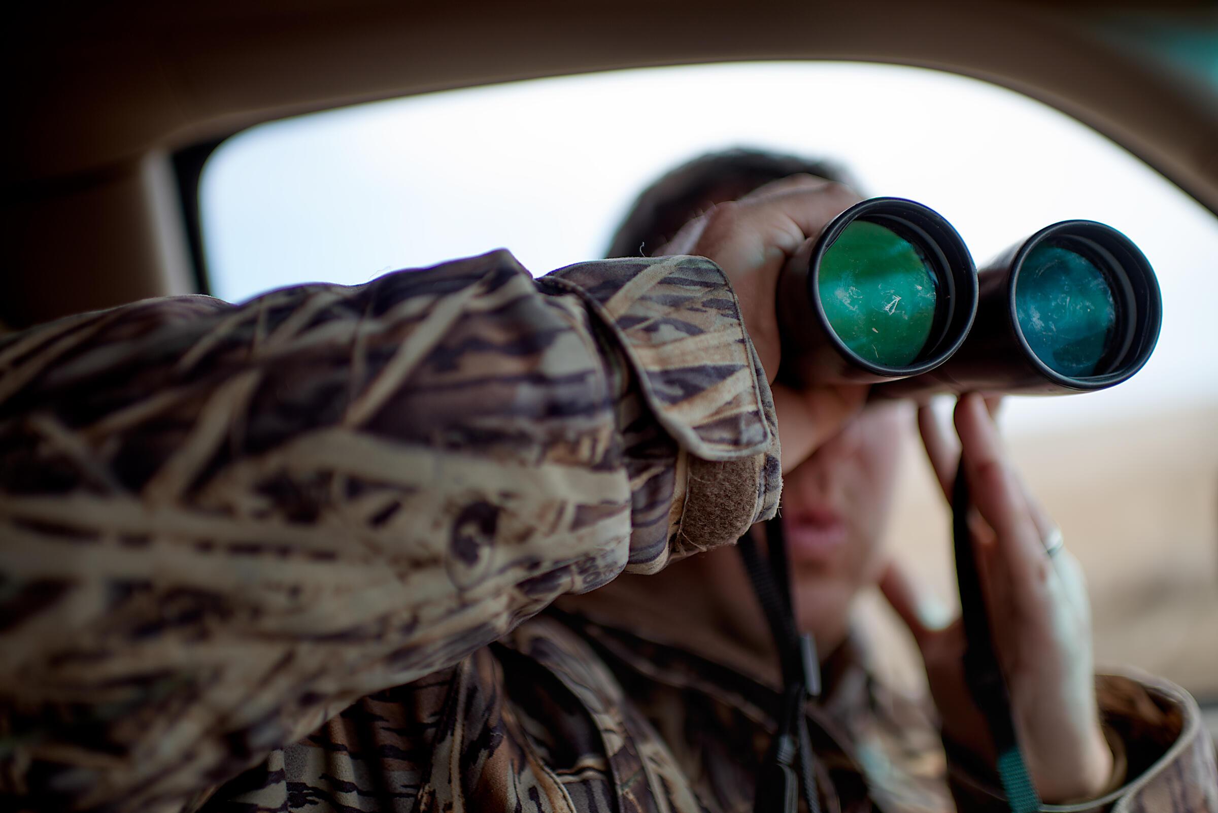 Grimm scouts the back roads near Eureka, South Dakota, for birds to photograph. Jon Lowenstein