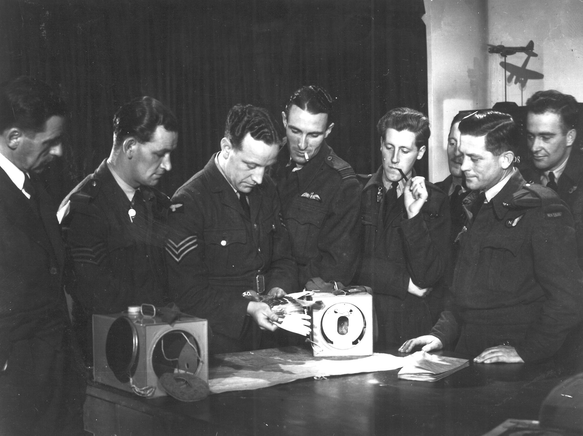Many pigeons were dropped by aircrews to deliver messages to troops on the ground. Here, aircrews are trained in the correct deployment of the plucky birds. AR/BNPS