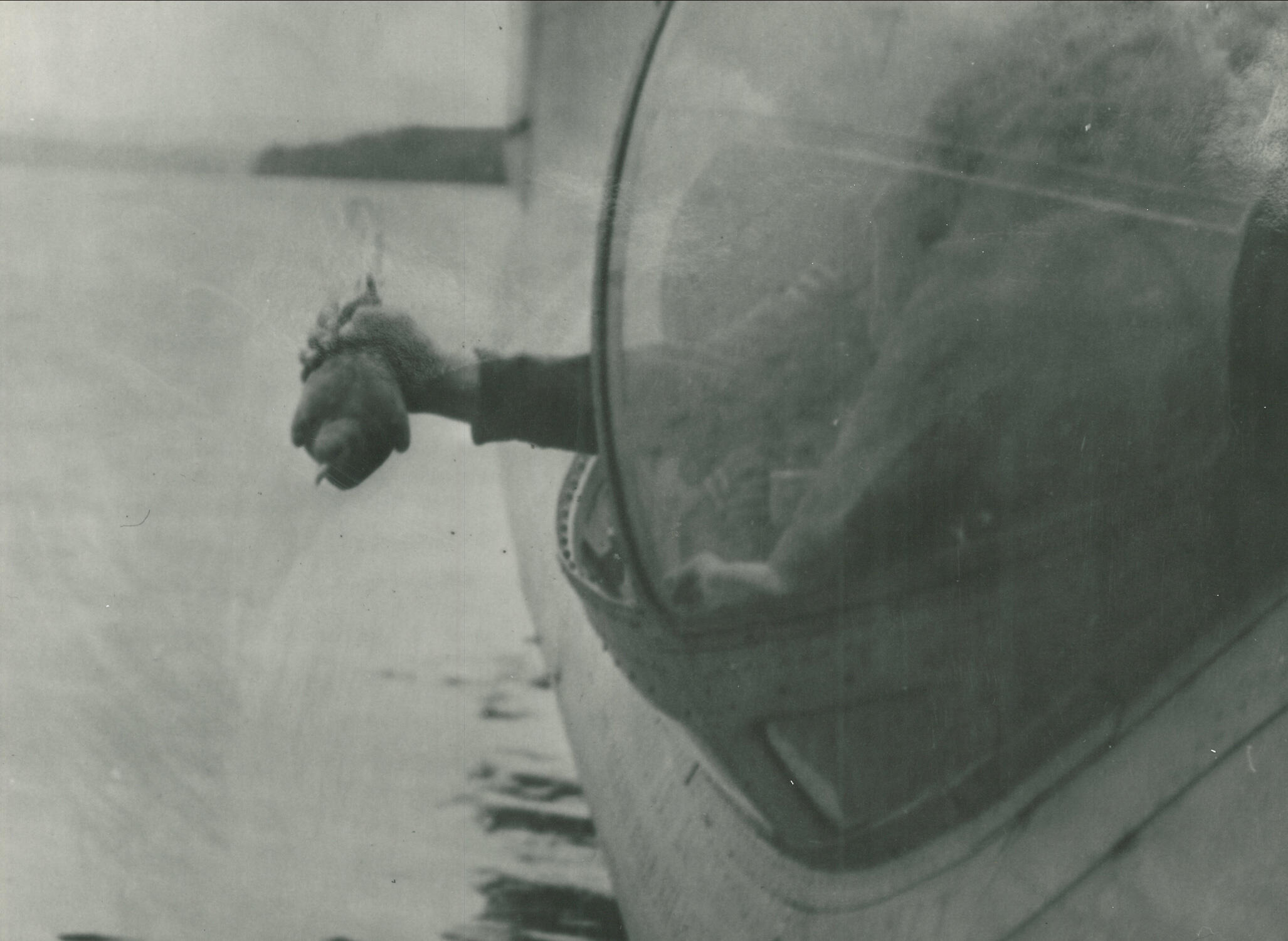 A pigeon is released from a Catalina flying boat. They were occasionally strapped into mini parachutes to ensure a safe landing. Often, coded intelligence messages were strapped to the birds' bodies. AR/BNPS