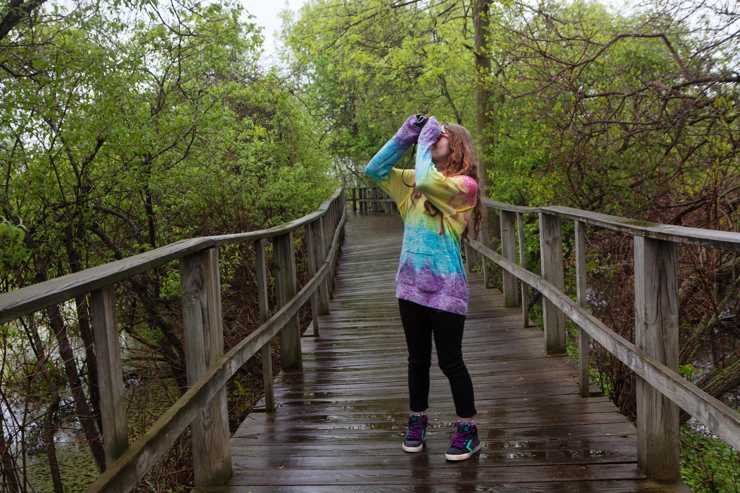 A teenaged birder on the Magee Marsh Boardwalk. Camilla Cerea/Audubon