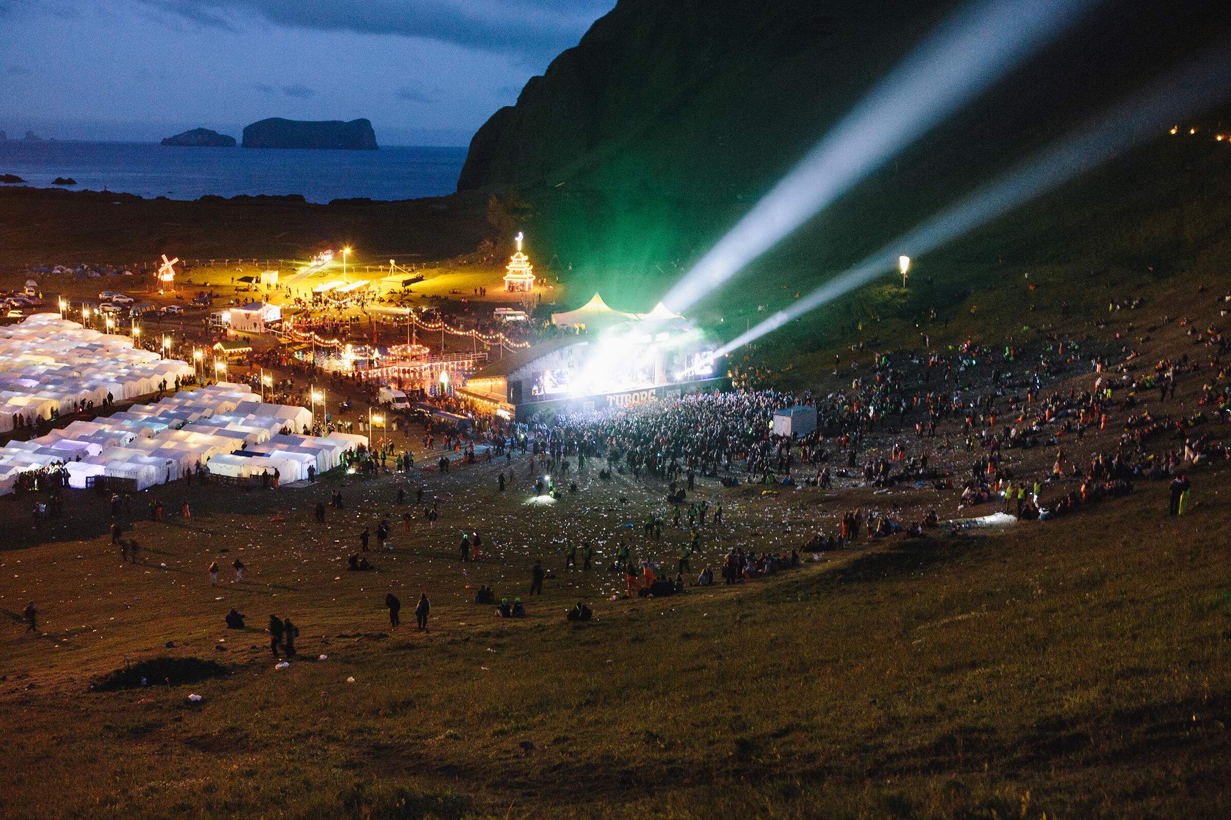 Festival activities include singing, dancing, and drinking on the mountainside. Tristan Spinski