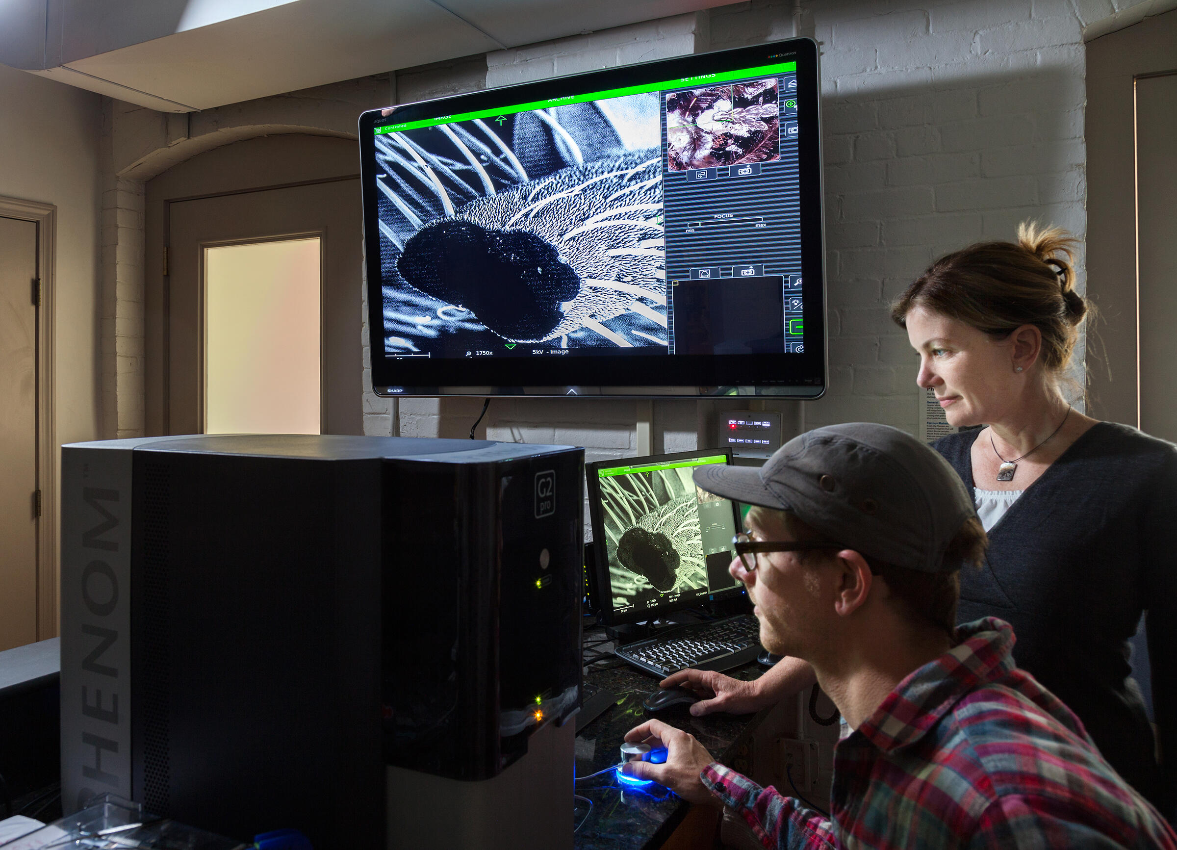 Staffer Jennifer Bissonnette helps a RISD student negotiate the nature lab's $85,000 scanning electron microscope. Richard Barnes