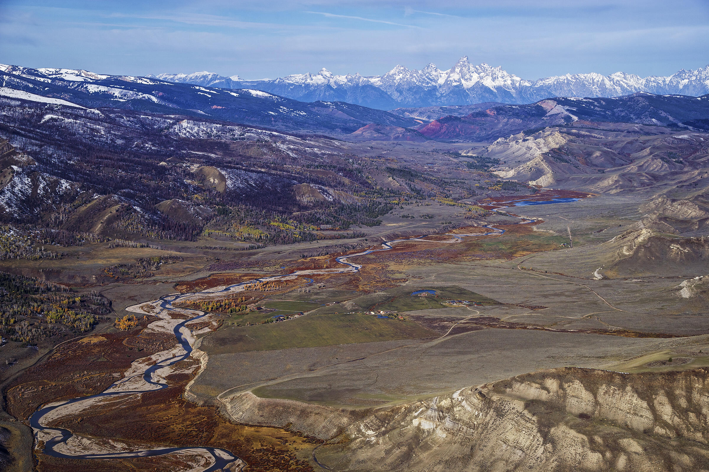 """This aerial view of the Gros Ventre River Valley shows a large swath of the """"path of the pronghorn"""" migration corridor, with the Teton Range as a backdrop. Bridger-Teton National Forest, Wyoming. Dave Showalter"""