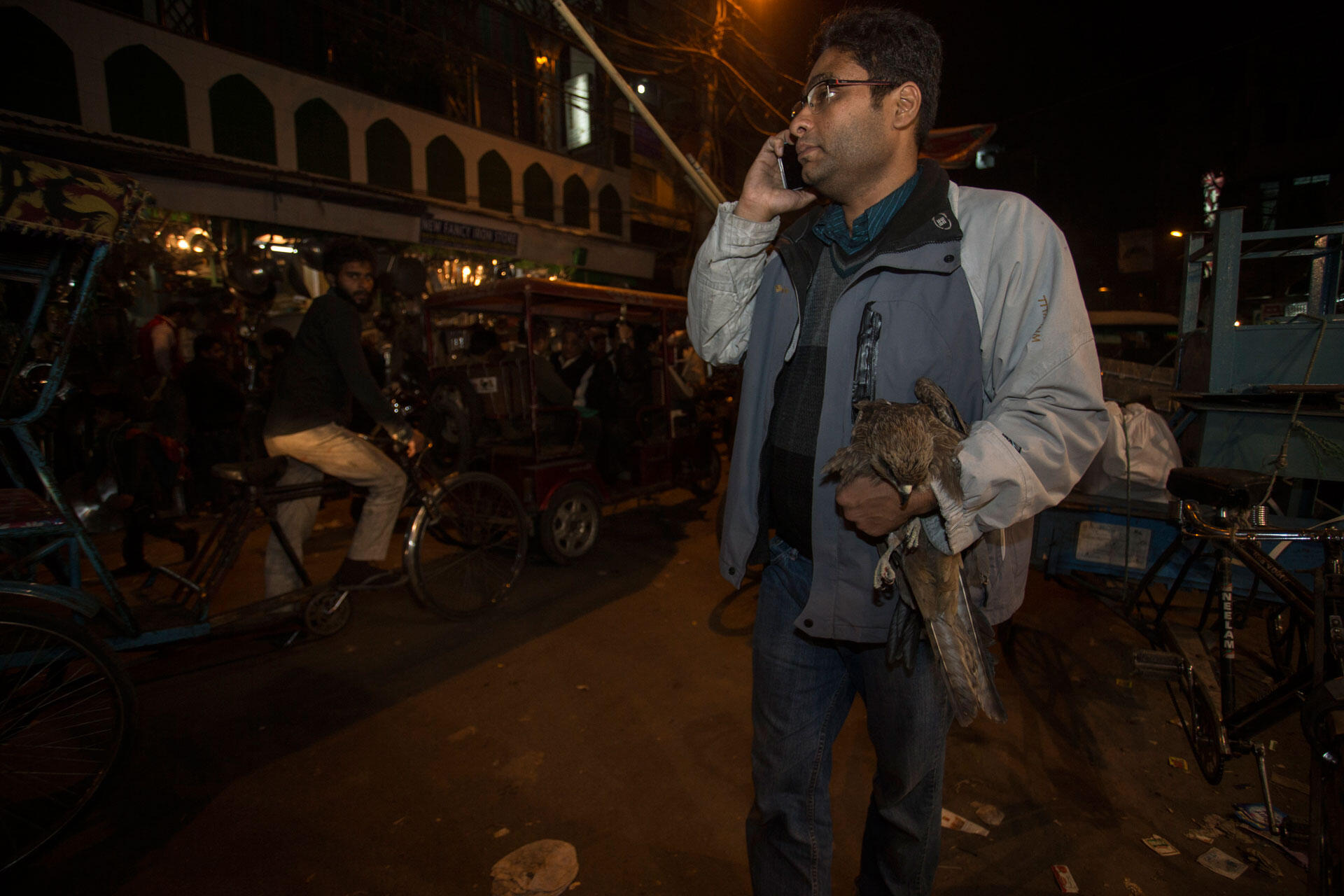 Nadeem Sherzhad carries a rescued bird back to his house for treatment. Luke Massey