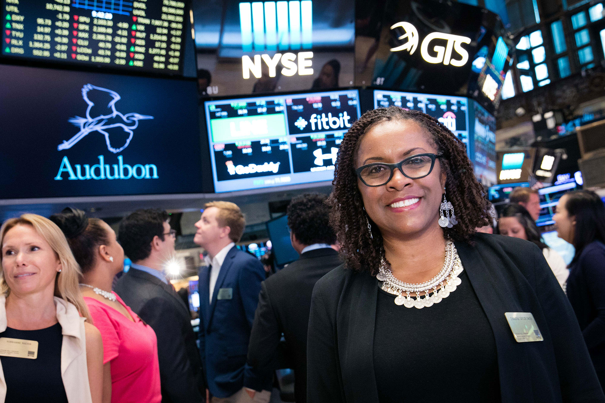 Robbianne Macklin (left) and Chandra on the floor of the New York Stock Exchange. NYSE/Valerie Caviness