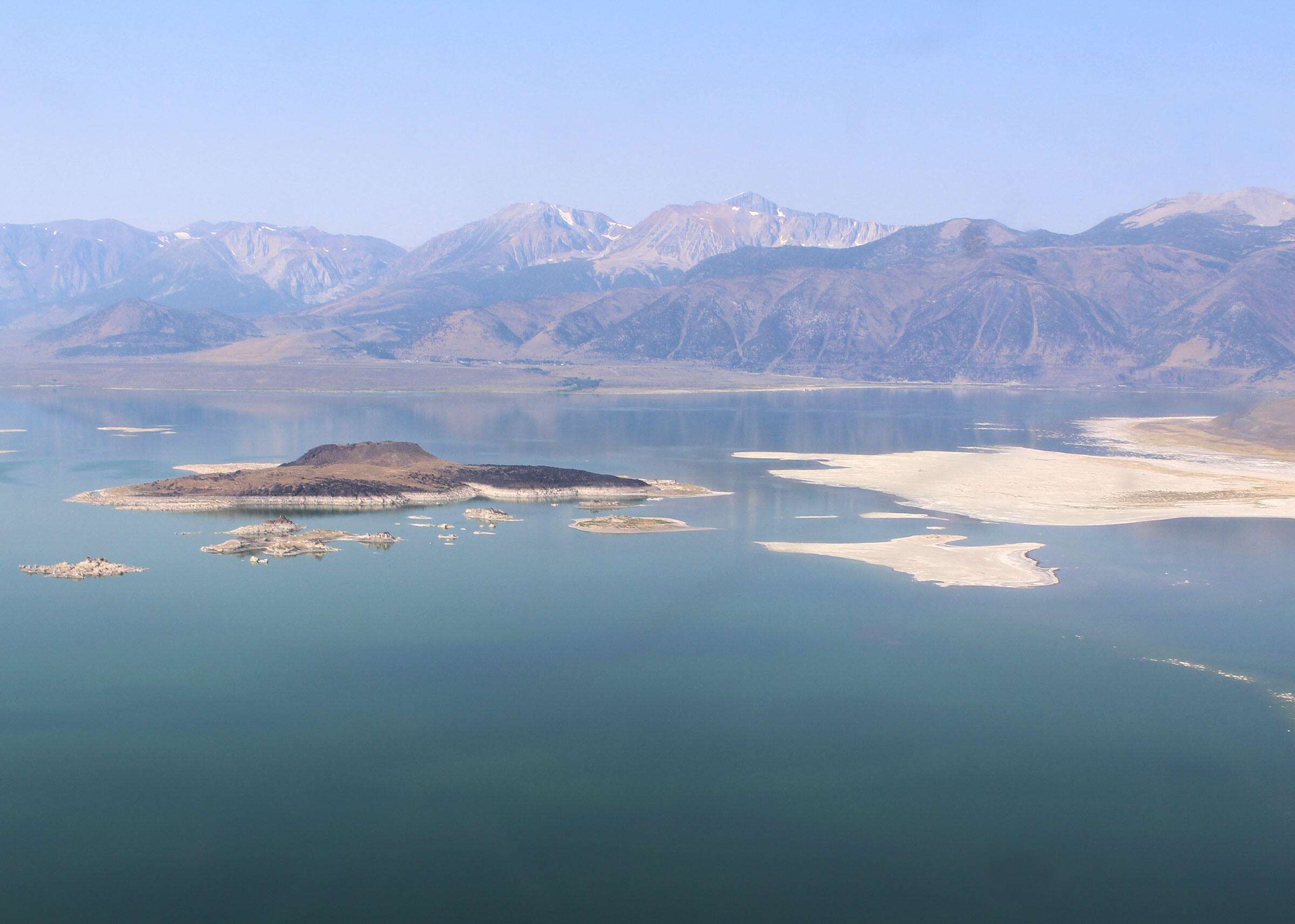 An aerial view reveals the emerging landbridge. Courtesy of Mono Lake Committee