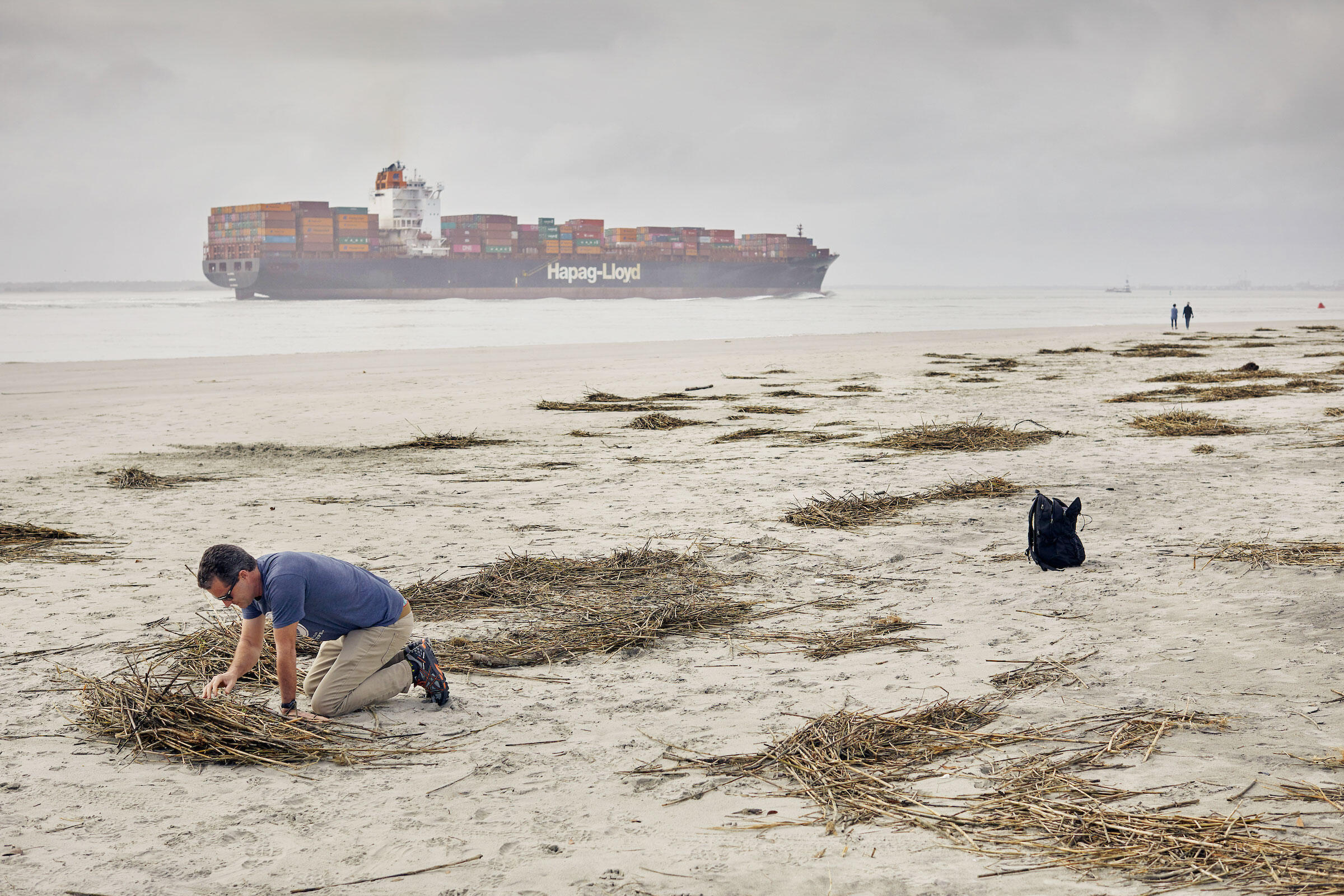 Clean-water advocate Andrew Wunderley surveys a South Carolina beach for tiny pellets that are turning up on its shores as plastics exports grow. Justin Cook