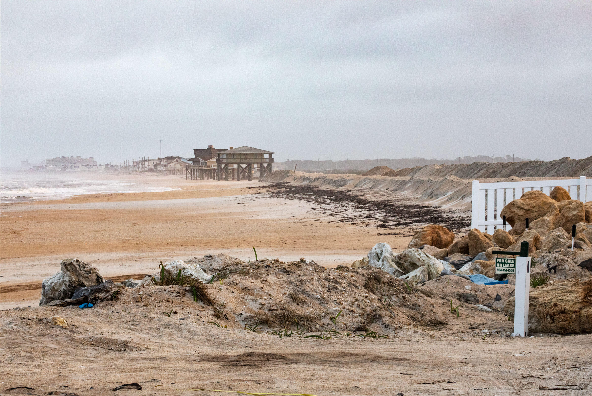 The sea has consumed the road to the resort community of Summer Haven, leaving it only accessible by trekking across the beach at low tide. Andrew Moore