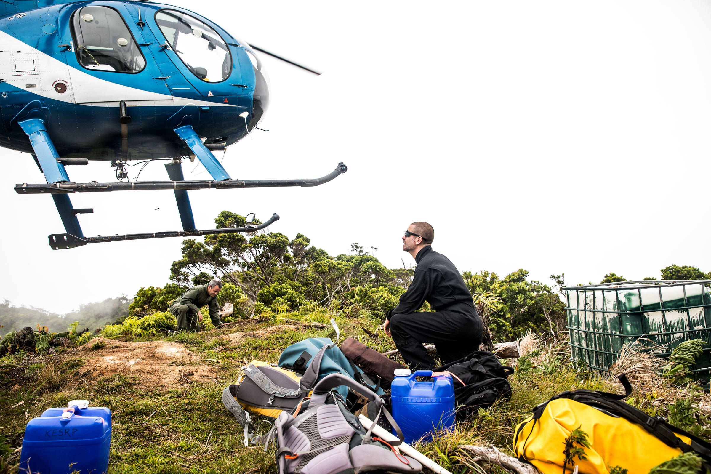 The terrain means Raine (right) must rely on a helicopter to deliver both his team of petrel and shearwater searchers and their supplies. Tom Fowlks