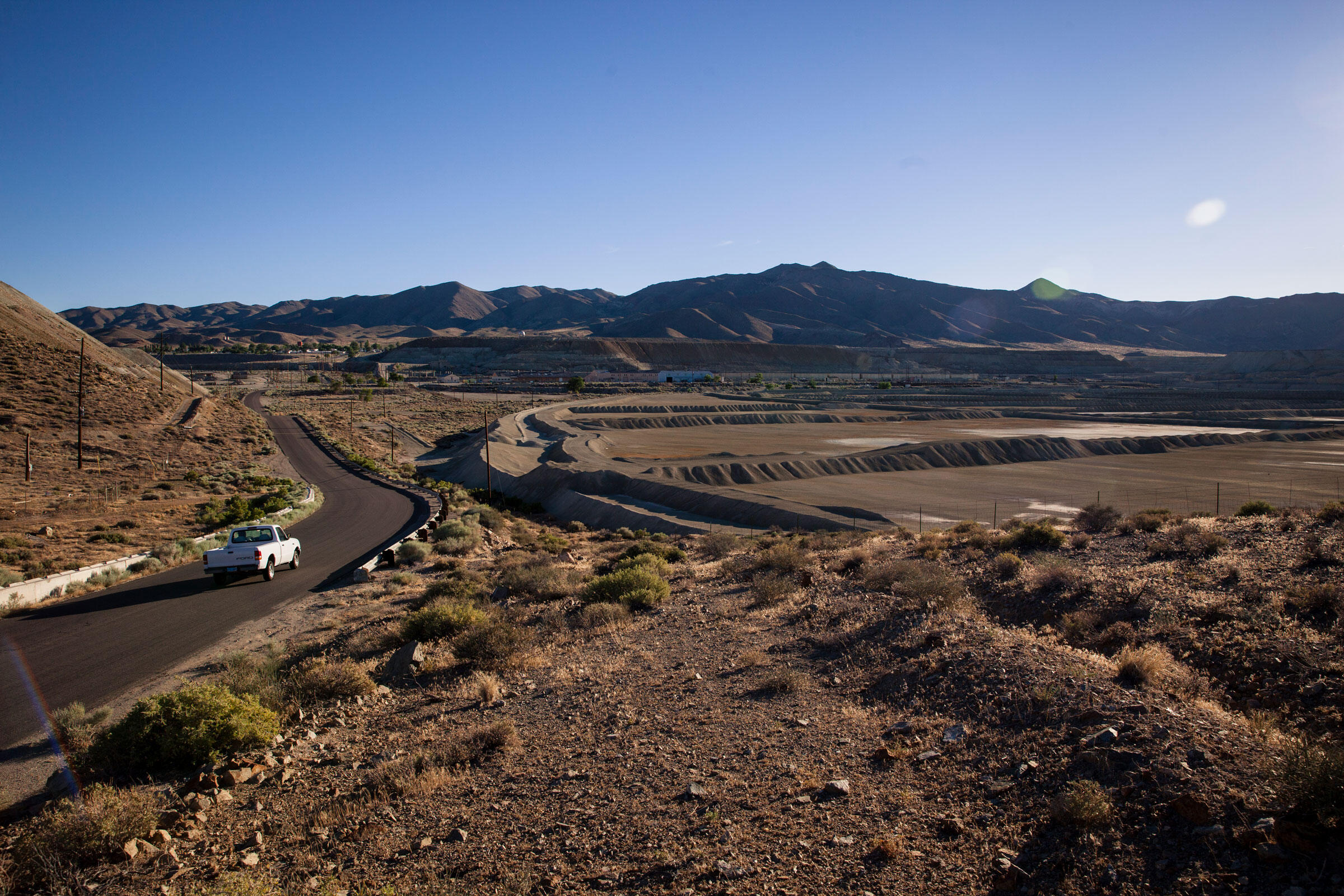 A truck passes by the Anaconda Copper Mine, one of the nation's largest toxic waste sites. Maggie Starbard