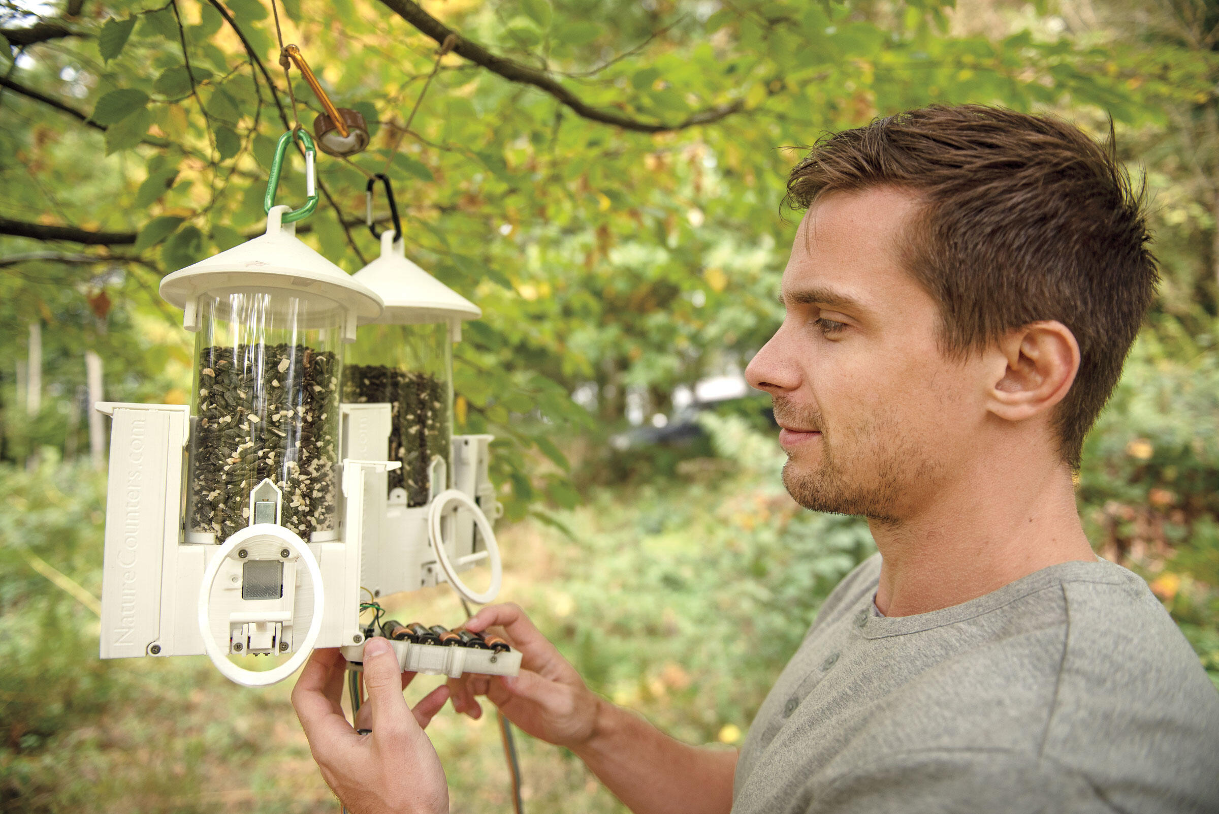 Josh Firth tinkers with cooperation feeders. Designed to open only when two specific birds arrive simultaneously, the gadgets help reveal the conditions under which individuals work together. Sam Hobson