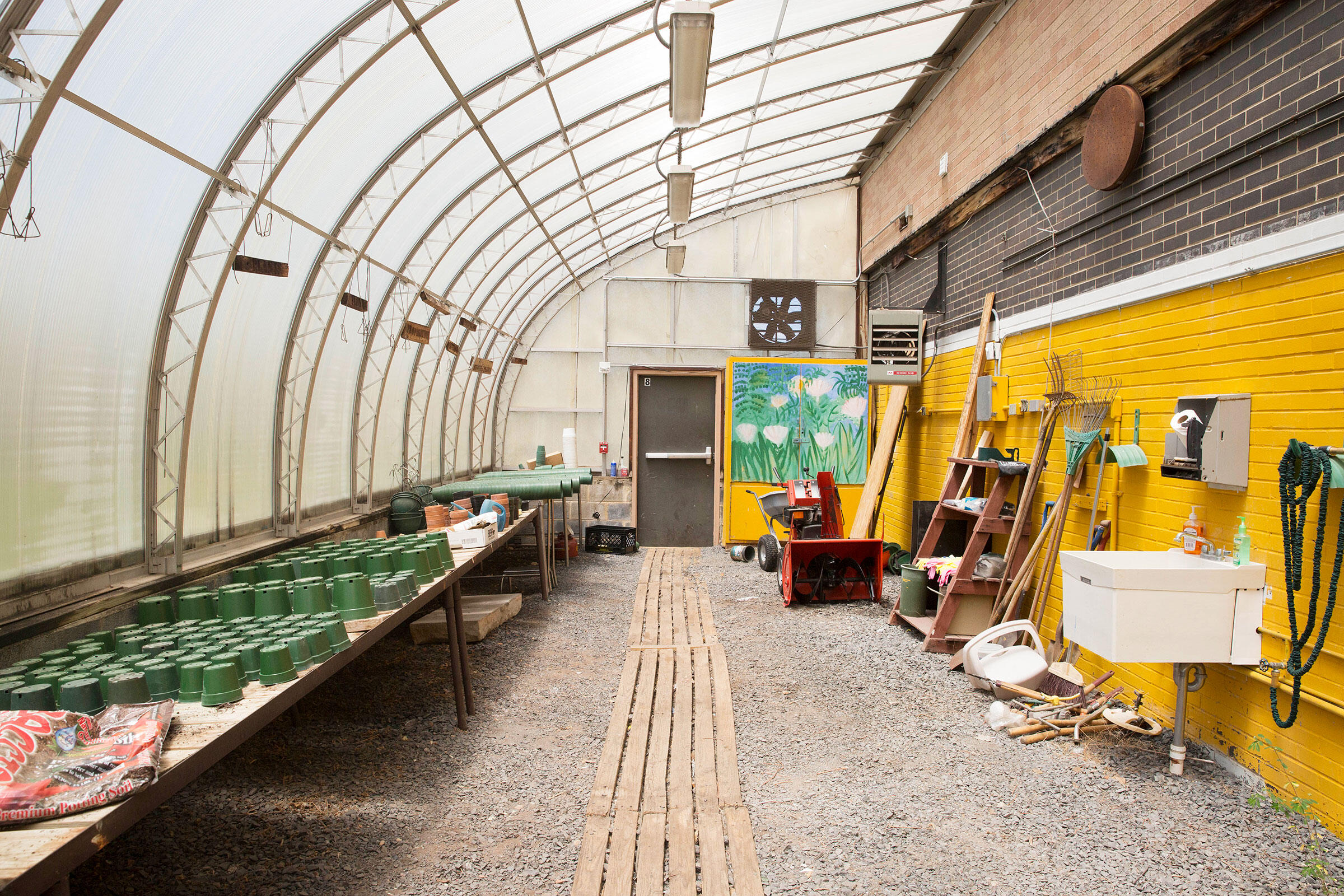 The greenhouse at the Roosevelt Alternative School needed a fresh coat of paint, among other things. Local grants helped fund an overhaul, and by this spring the structure was ready for plantings again. Rachel Wisniewski