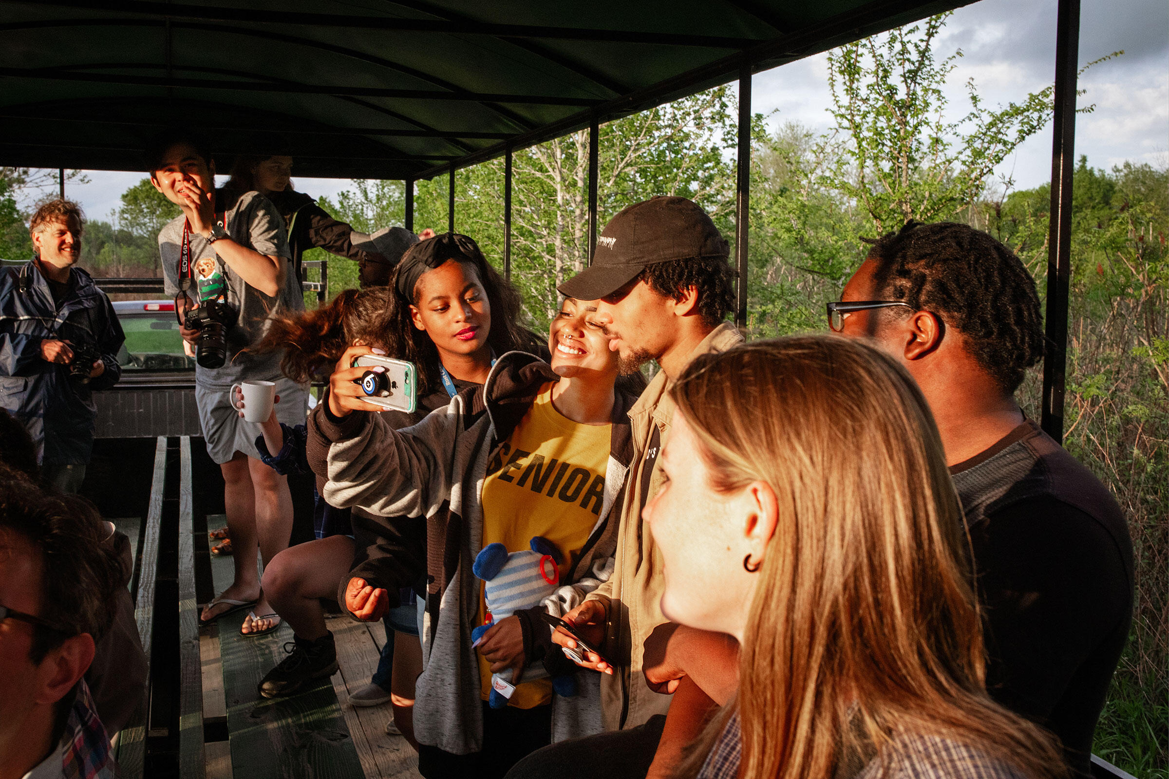 Students from Rust College and University of Mississippi take a moment for a selfie during a wagon ride through Strawberry Plains Audubon Center's early successional habitats. Mike Fernandez/Audubon