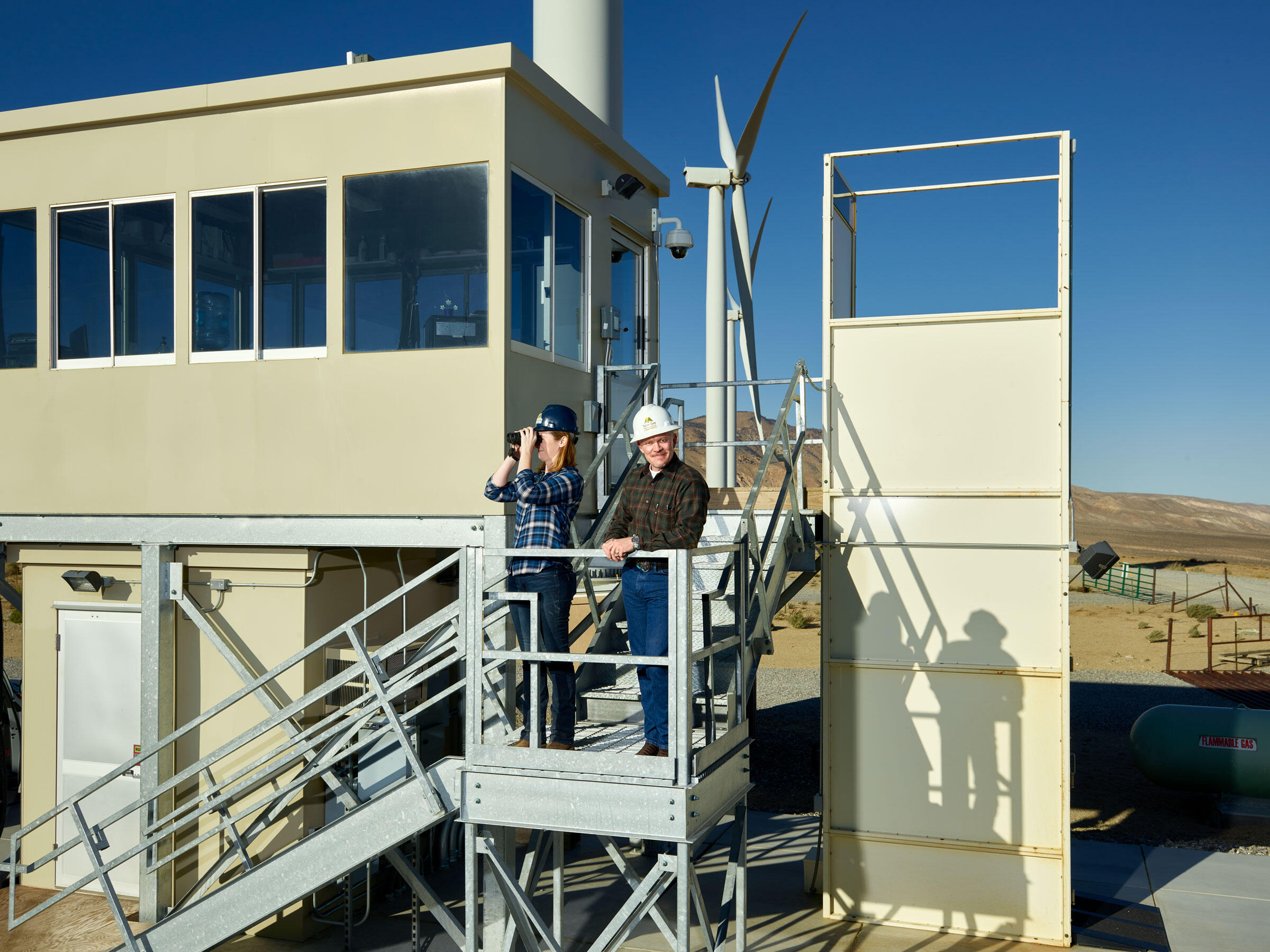 From right: Amanda Wilhelm and Kevin Martin stand outside Alta Environmental Services' observation tower, the center of its condor-detection system. Spencer Lowell