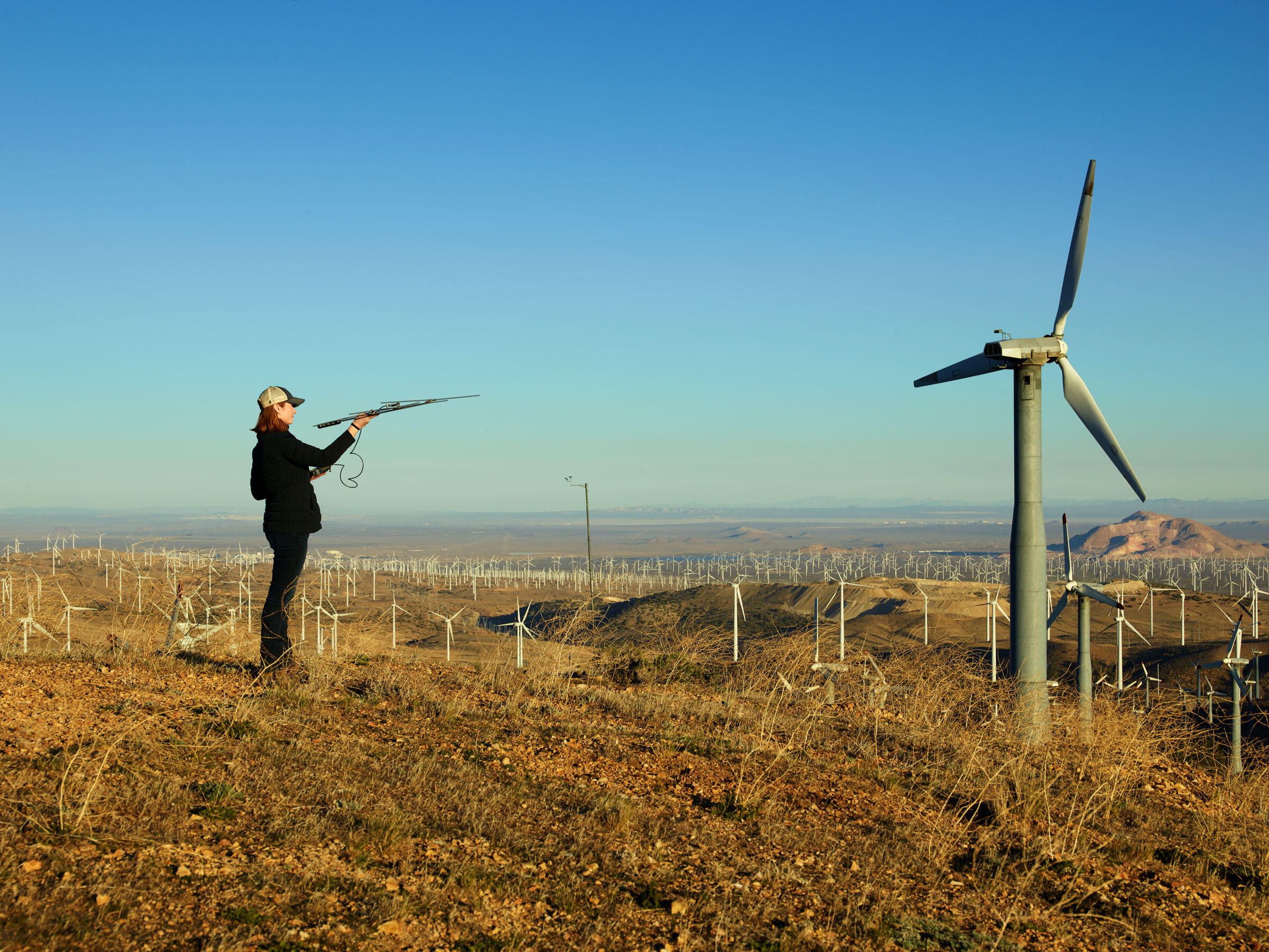 Amanda Wilhelm, Terra-Gen's field team leader, using a handheld antenna to scan for condors at the Tehachapi Wind Resource Area in Kern County, California. Spencer Lowell