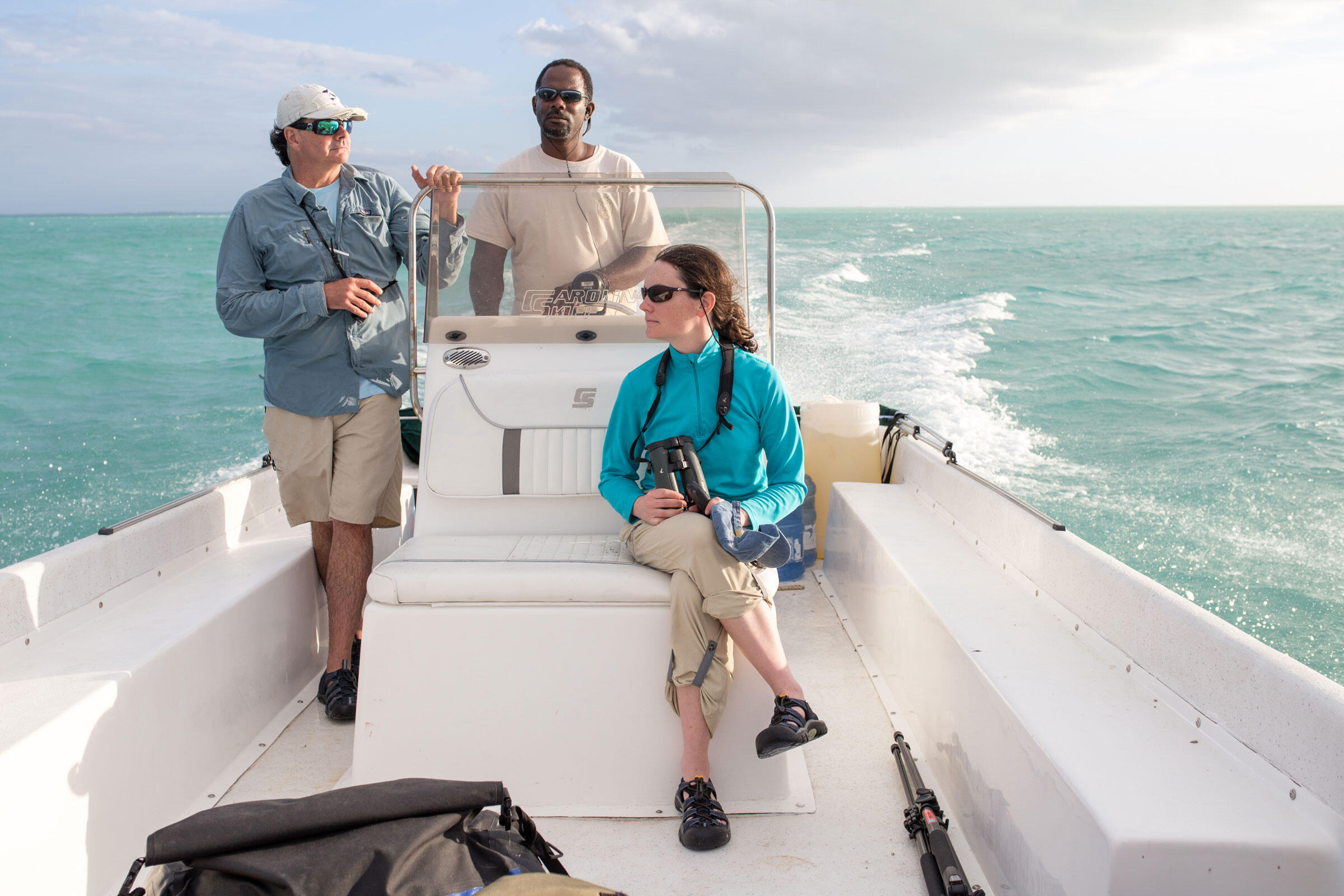 Island hopping: The team spent hours cruising the waters north of Andros, prowling for plovers (and sharks) on small motorized boats. They were led by BNT warden, local resident, and expert navigator Steve Smith (middle). Camilla Cerea/Audubon