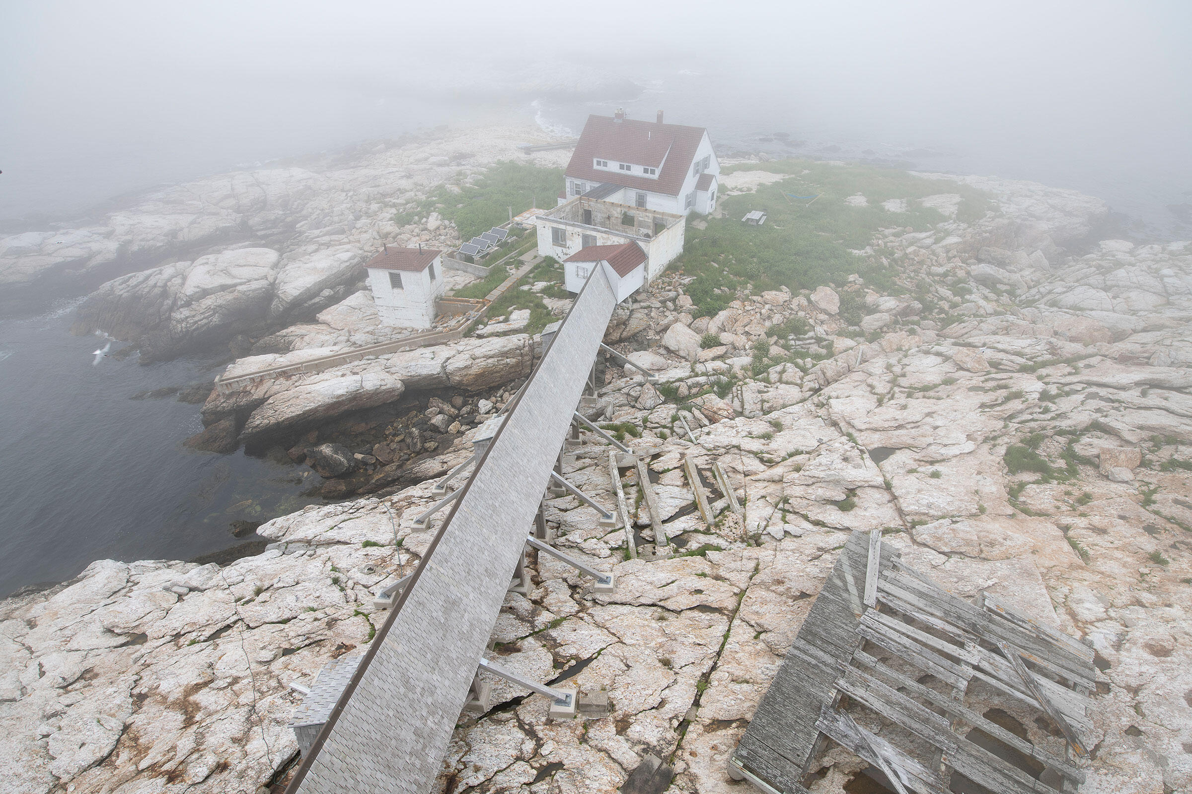 Lighthouse keeper's hut and covered walkway leading to the lighthouse. Chris Linder