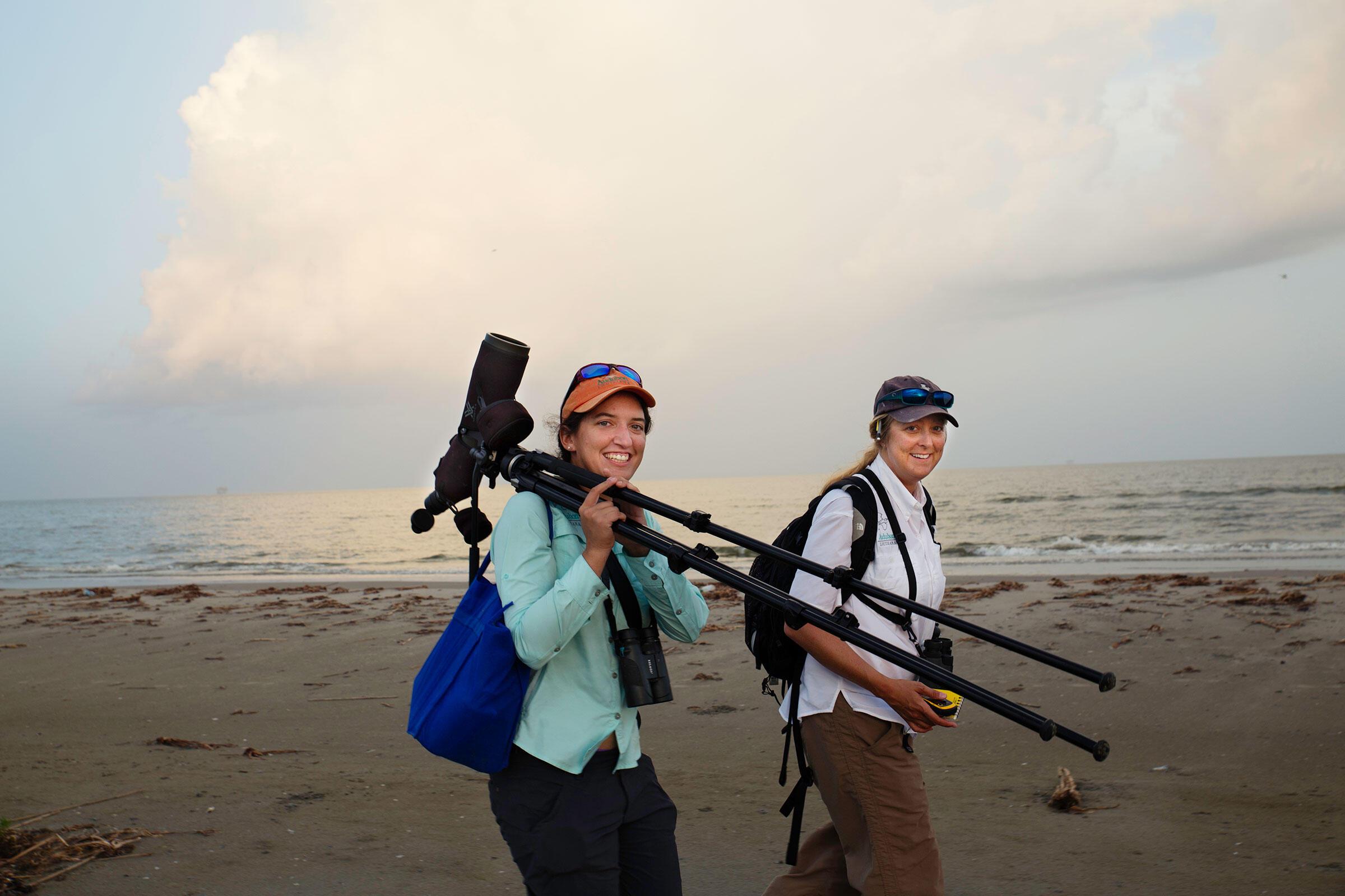 Audubon Lousiana wildlife techs Sarah Bolinger (left) and Melinda Averhart monitor birds on newly restored beaches. Mike Fernandez/Audubon
