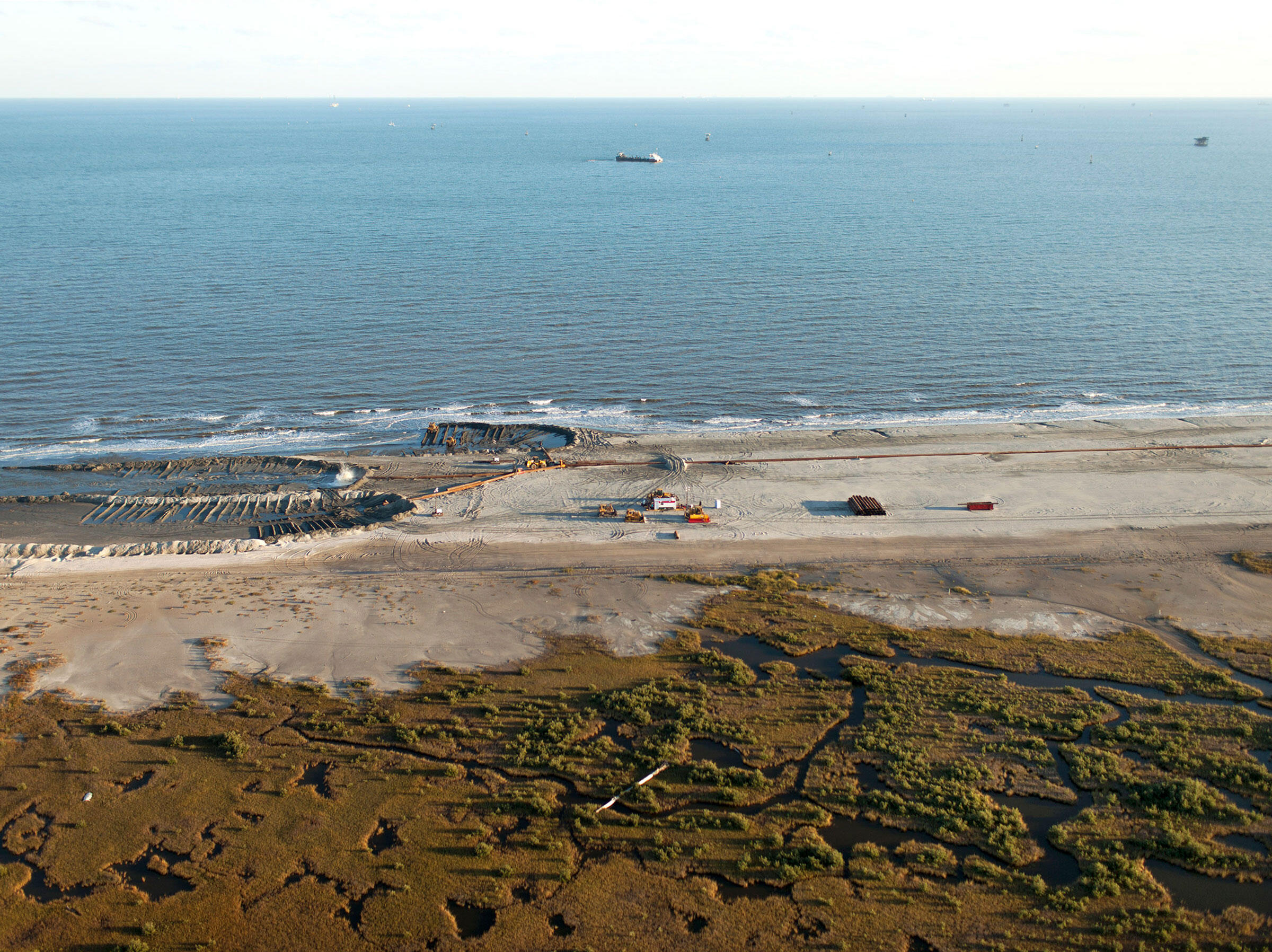 Constructing more than 1,000 acres of new barrier, dune, and beach habitat on Elmer's Island involved bringing in 9 million cubic yards of sand. Ben Depp