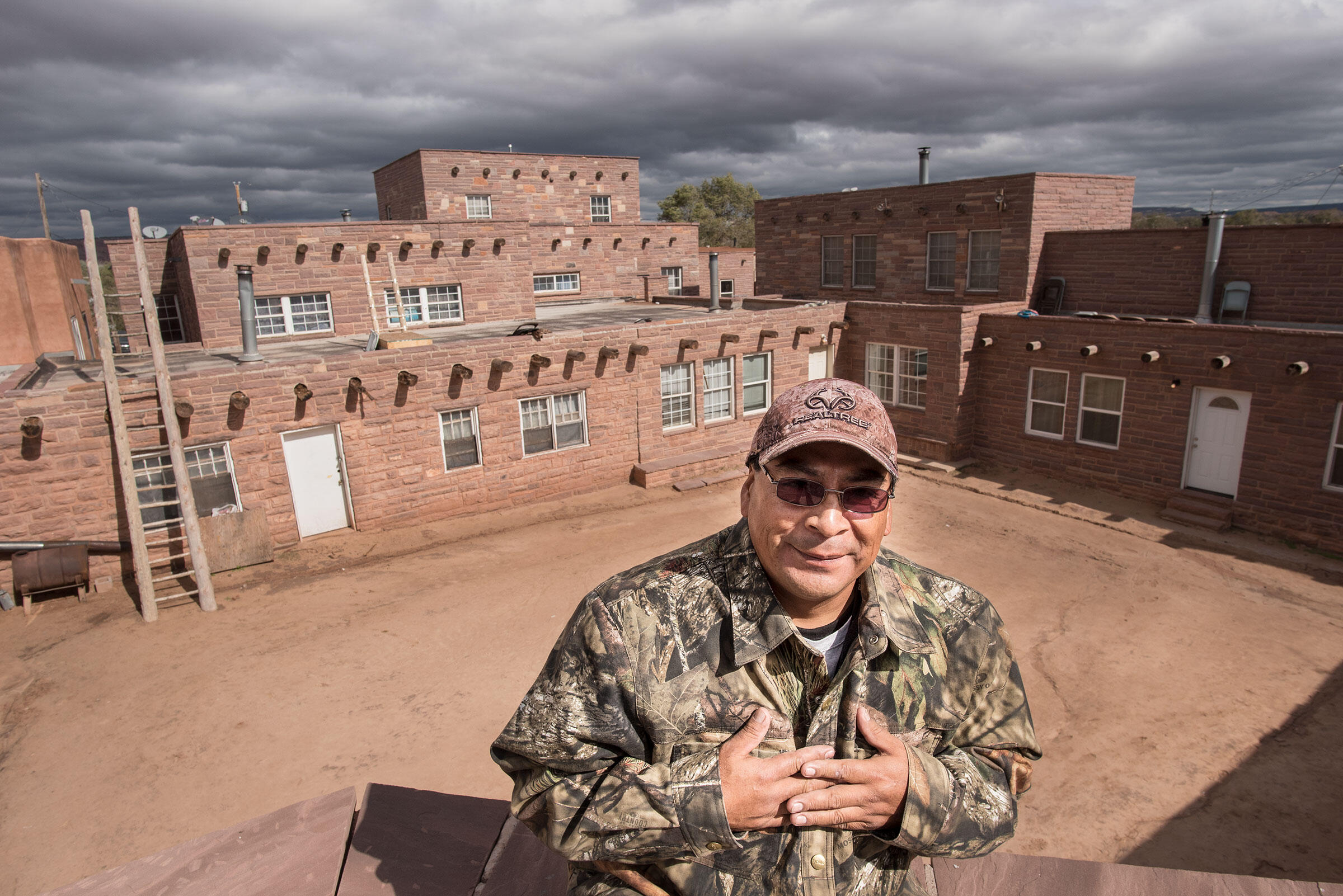 Kenny Bowekaty in front of the plaza in Zuni Pueblo considered the Heart of Mother Earth. Dawn Kish
