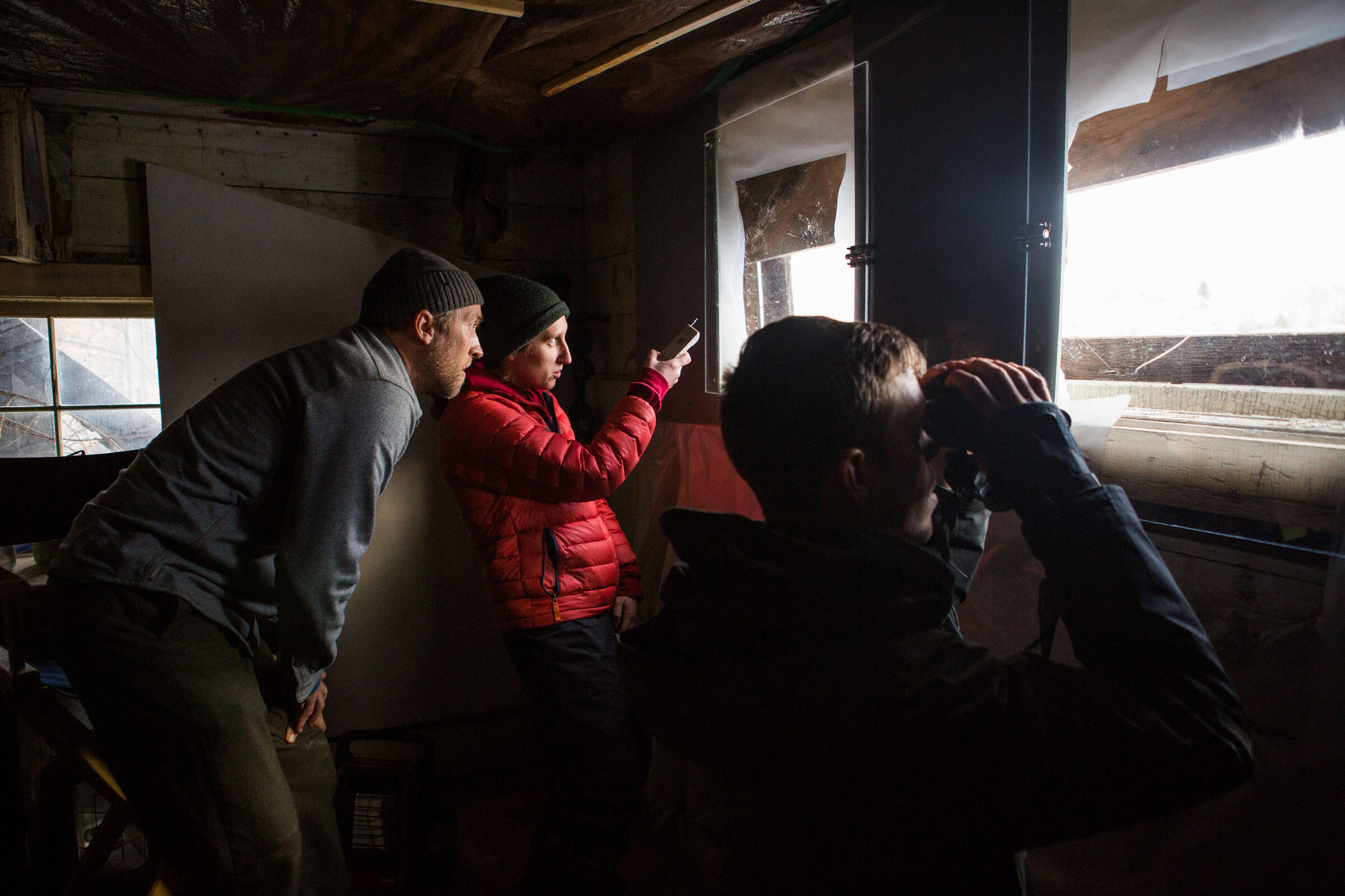 Hidden inside a former carriage house, RMVI's Eric Rasmussen, Mary Scofield, and Brian Busby look for eagles. Celia Talbot Tobin