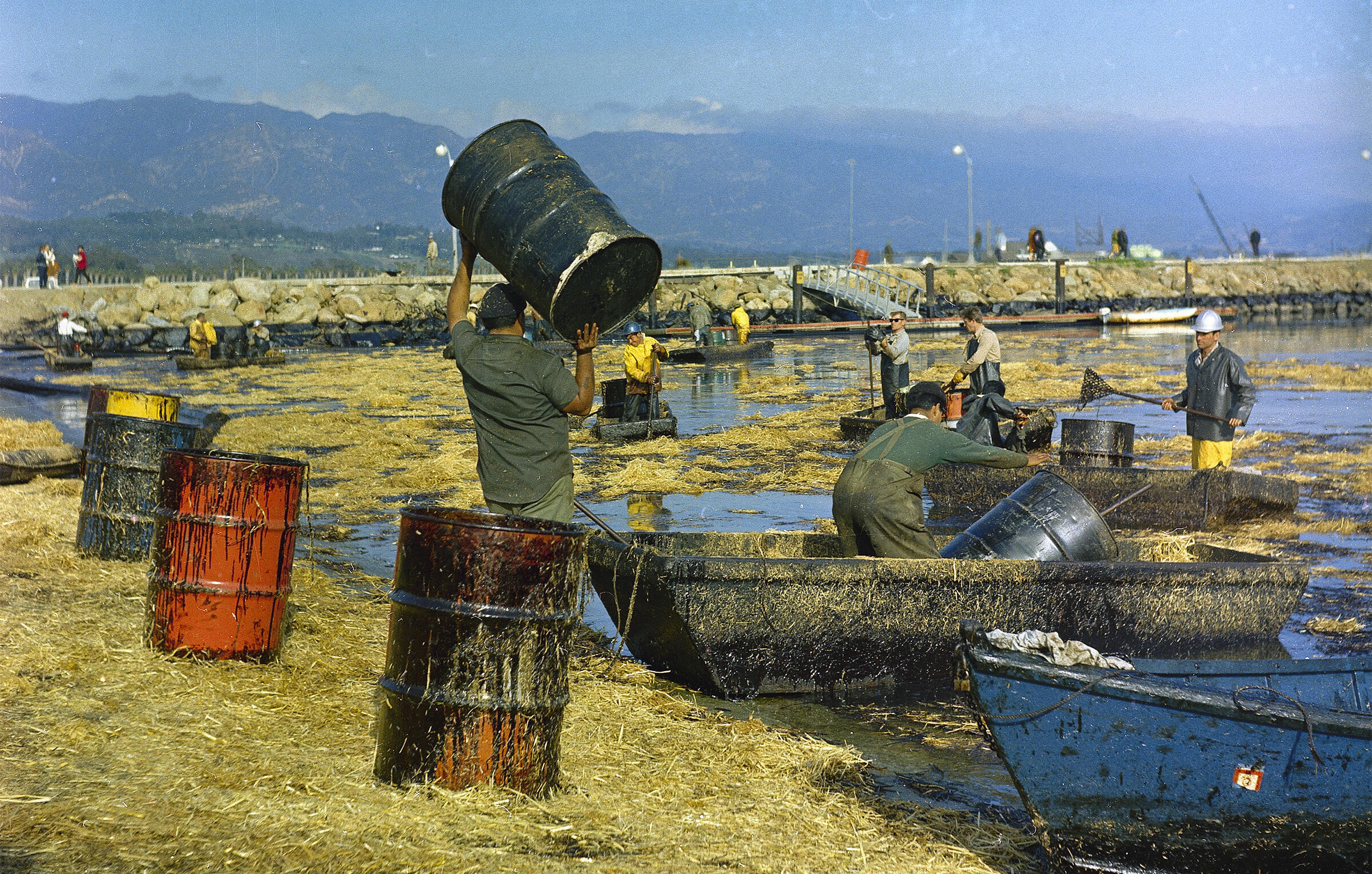A 1969 explosion leaked millions of gallons of oil into the sea. Straw placed to absorb oil is shoveled and racked off the beach at Santa Barbara Harbor. AP Photo