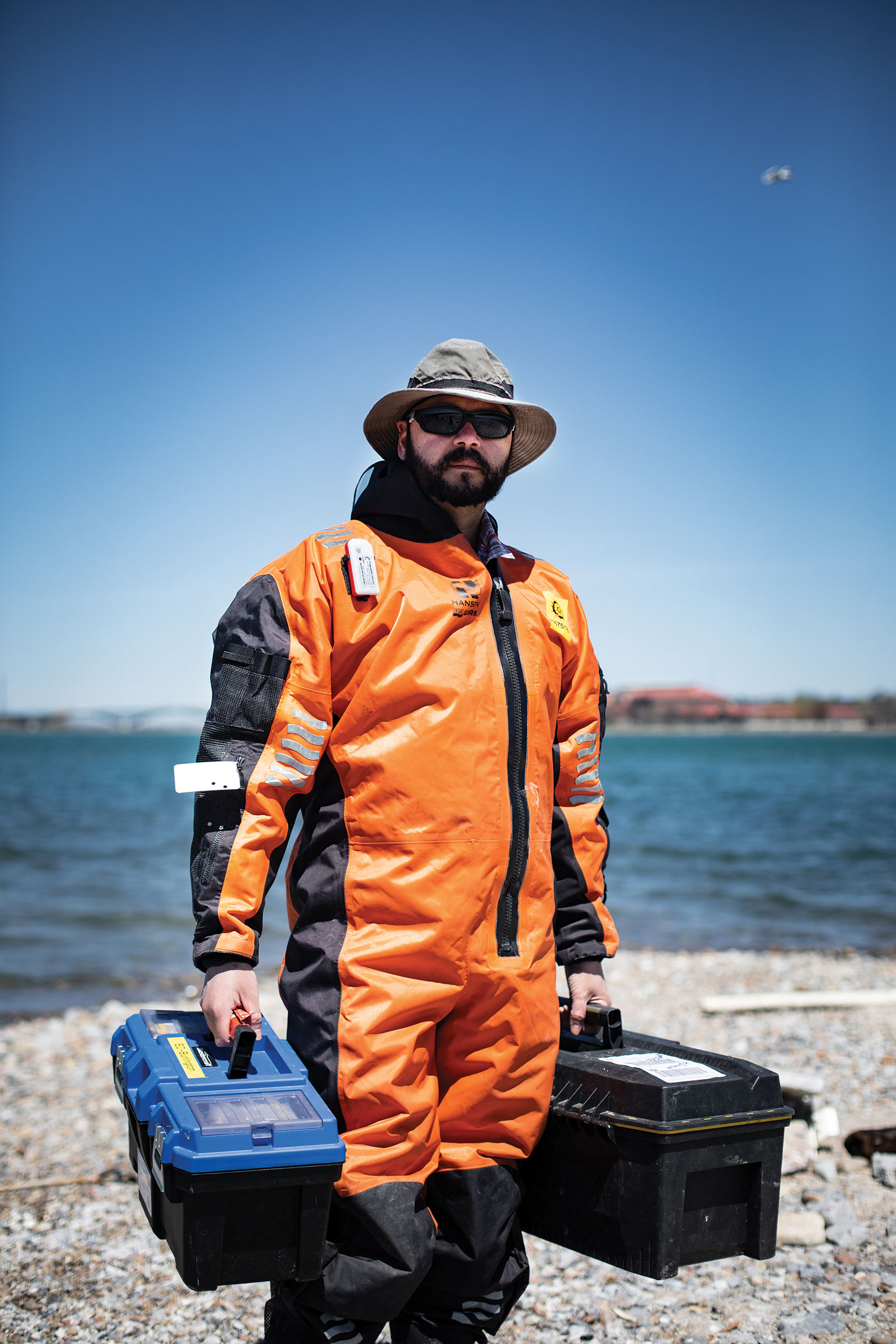 Shane de Solla, an ecotoxicologist and survey leader for the Herring Gull Monitoring Program, suits up to collect eggs for chemical testing. Scott Gable
