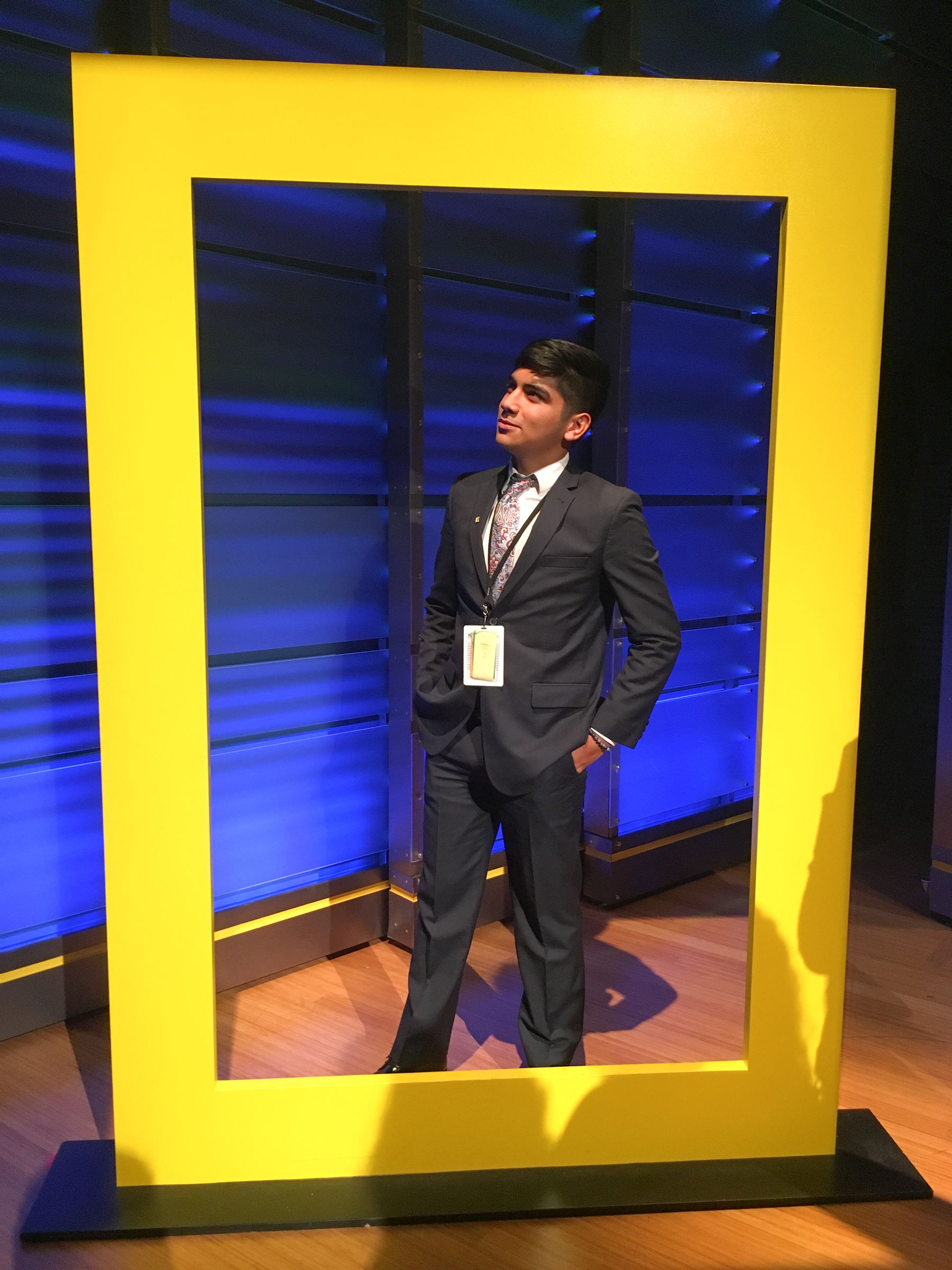 Ponce posing underneath the National Geographic logo at its headquarters in Washington, D.C., where he attended a youth summit on the environment. Courtesy of Alonso Ponce