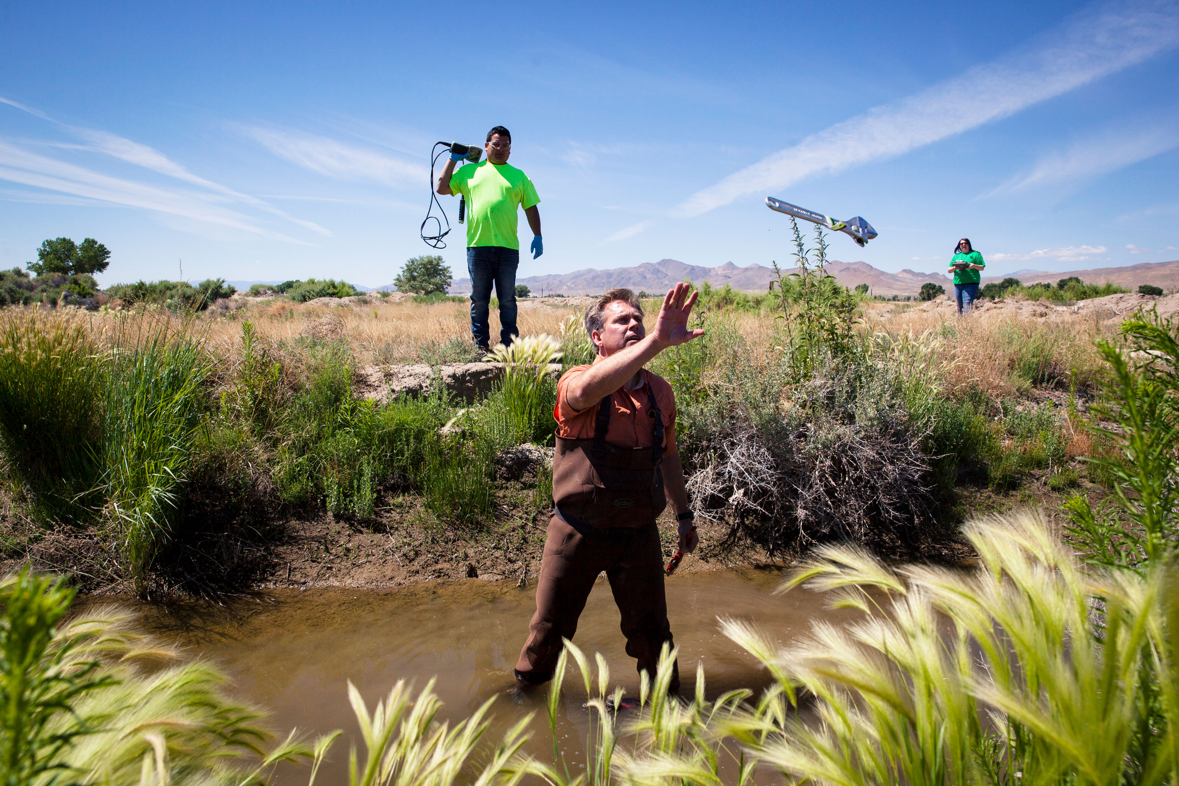 Dietrick McGinnis, environmental consultant for the Yerington Paiute Tribe, tests the water from the Tribal Wetlands. High levels of uranium, arsenic, and other toxins have been found in groundwater on the reservation. Maggie Starbard
