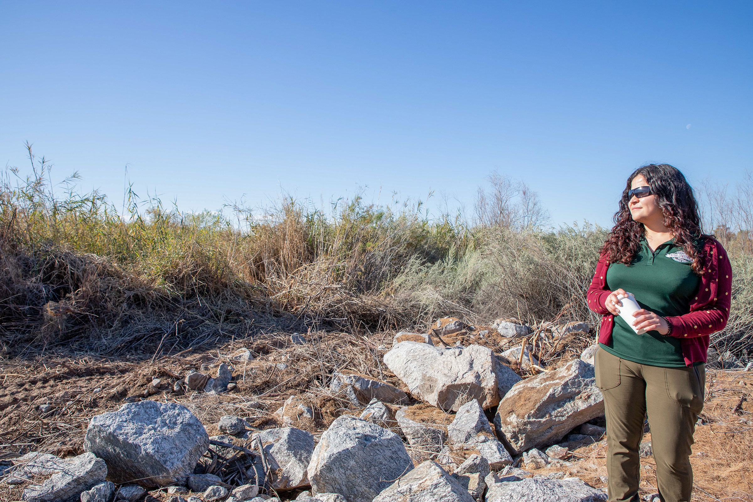 Vianey Avila of the Yuma Crossing National Heritage Area surveys the 17-acre invasive-plant grant project. Yuma, Arizona. Dominic Arenas/Audubon