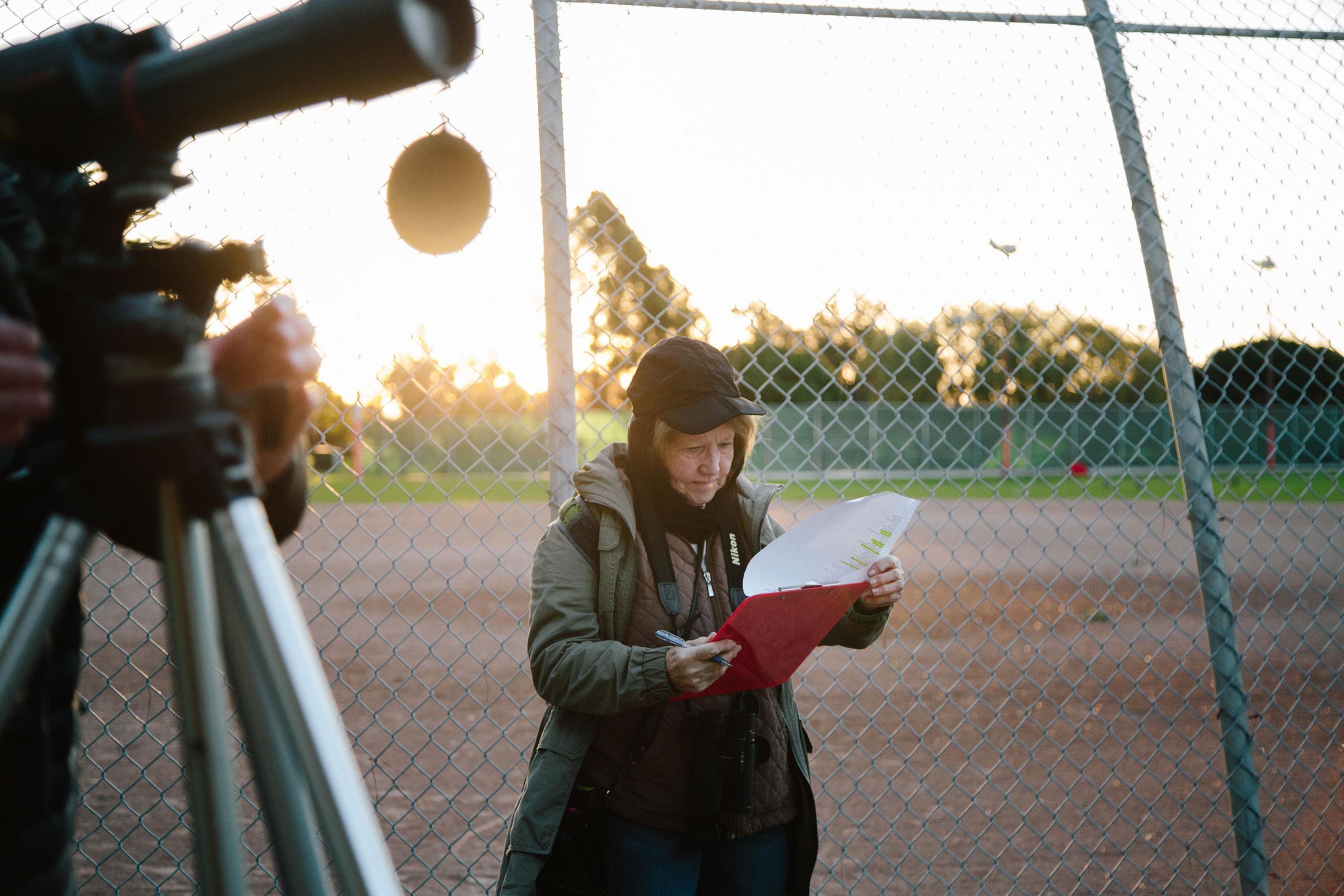 Angela Boyle checks off and tallies species in Alameda's Washington Park. Elizabeth D. Herman