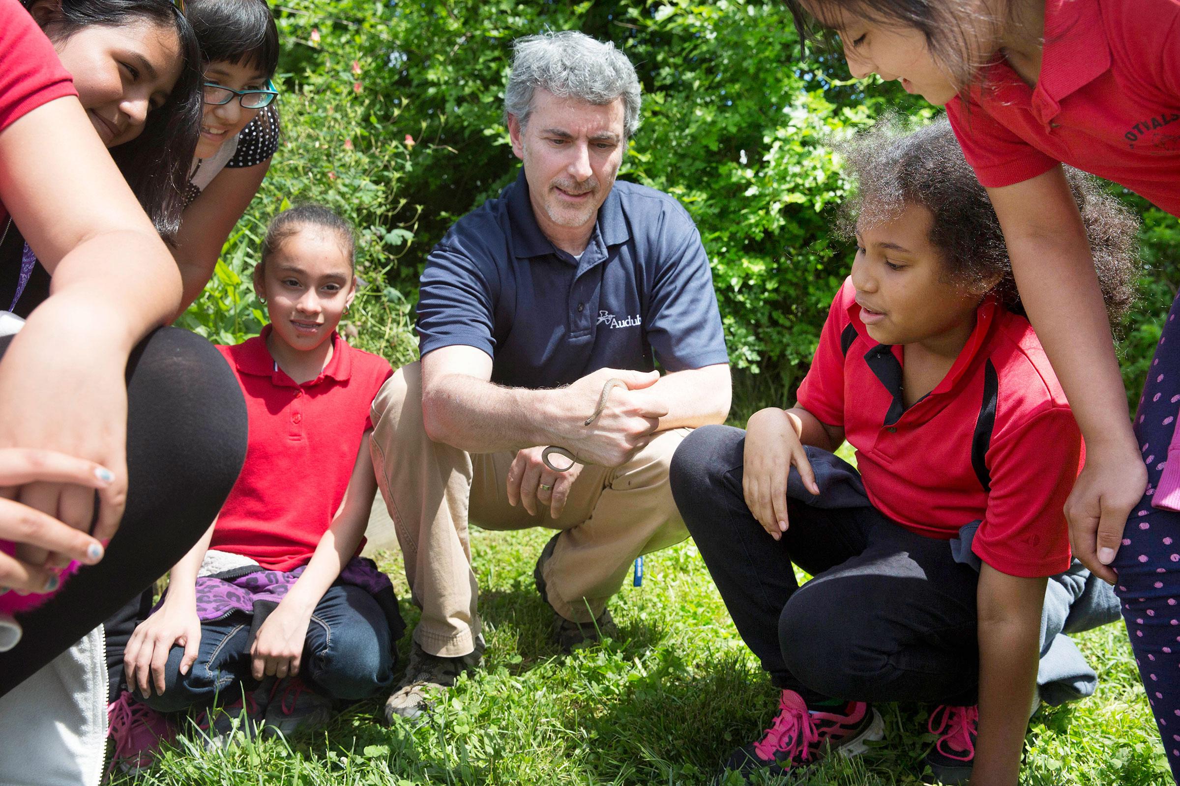 Steve Saffier, former Network Engagement Manager at Audubon Pennsylvania, shows off a garter snake during a science class at Gotwals Elementary School in Norristown. Rachel Wisniewski