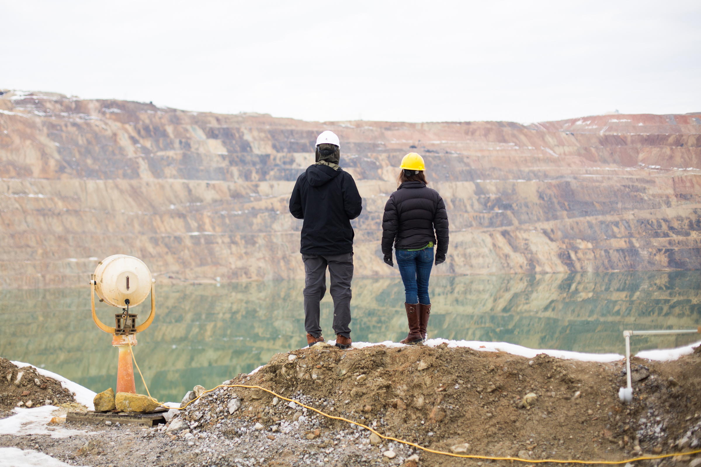 Stella Capoccia (right) and Mark Mariano Jr. look out over the pit. To their left sits a searchlight that was formerly installed in a prison and is now used to spotlight birds at night. Celia Talbot Tobin