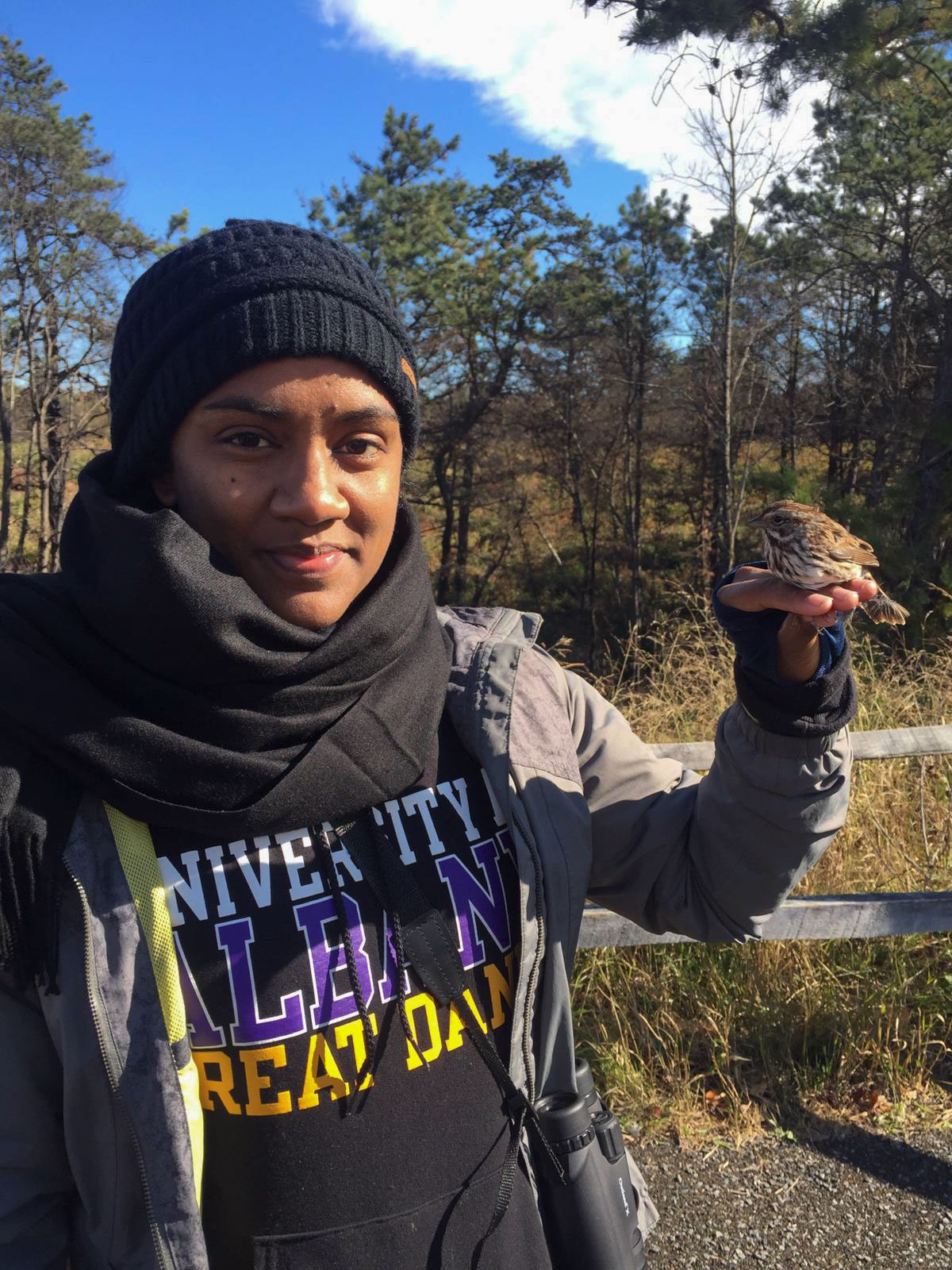 Bird banding at the Albany Pine Bush Preserve while pursuing her master's degree in Biodiversity, Conservation, and Policy at the University at Albany in 2019. Courtesy of Vero Couttee