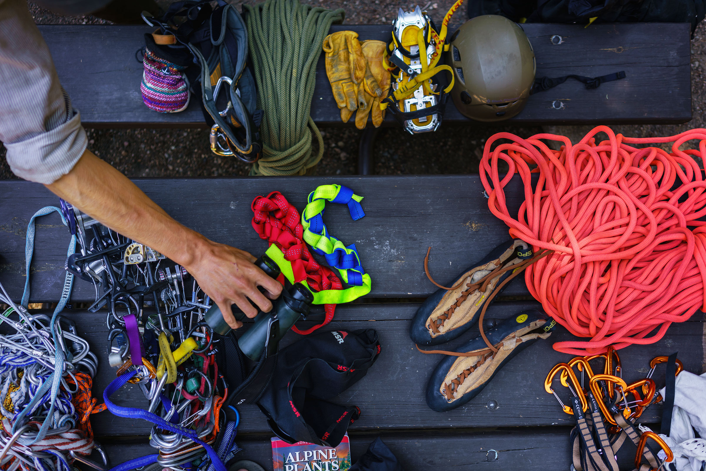 Prepping climbing gear to rappel to the site of inactive Black Rosy-Finch nests. Ronan Donovan
