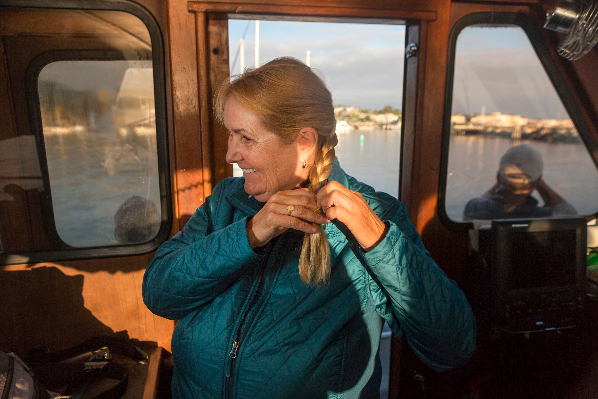 Shearwater braids her hair aboard Checkmate in preparation for one of her last tours with her company, Shearwater Journeys, in Monterey Bay. Lauren Owens Lambert
